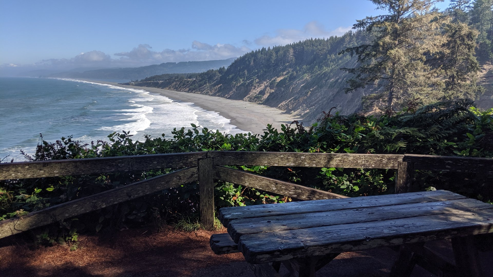 Agate Beach is littered with semi-precious stones, and seems to stretch beyond the limits of our vision. This table makes a fine rest spot after the steep climb up from the beach. | Photo by Jett Williams