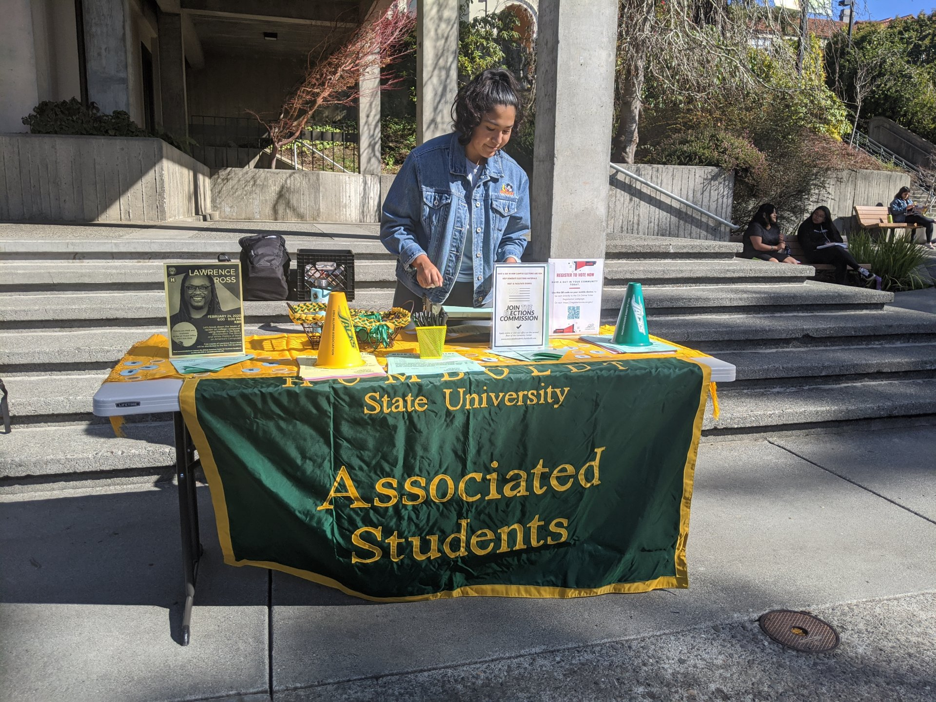 Associated Students Public Relations Officer Cassie Caudillo attends to the mock election table in the UC Quad on Feb. 24. | Photo by Sam Papavasiliou
