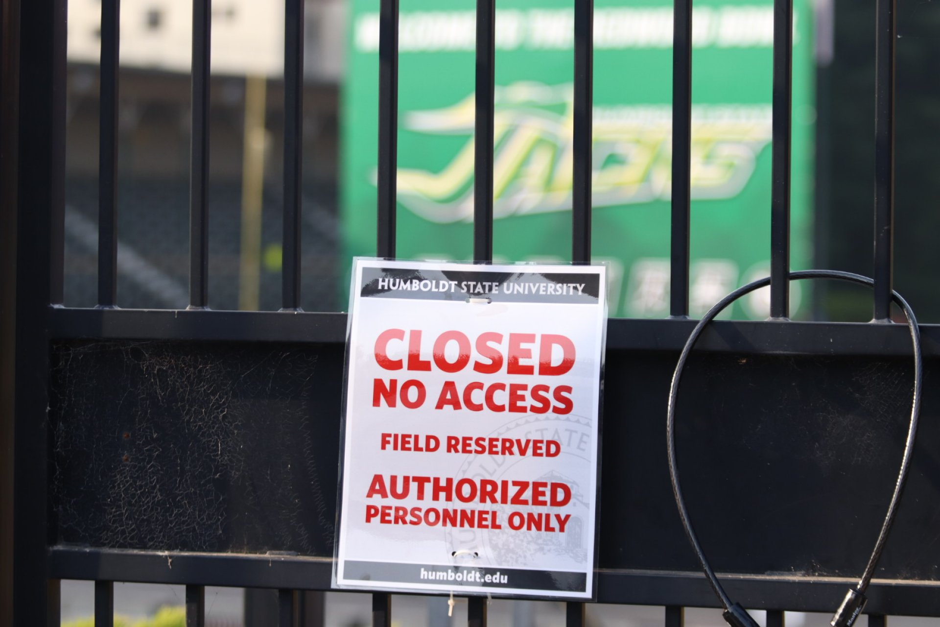 The gate leading down to the Redwood Bowl on the HSU campus with a closed access sign on Oct. 2, on the day that the San Jose State University football team arrives in Humboldt | Photo by Thomas Lal