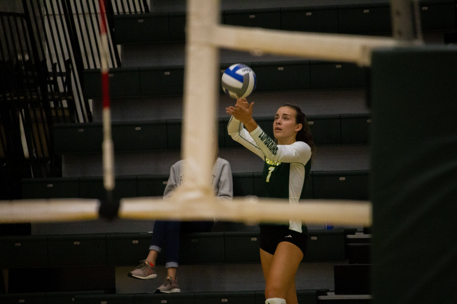 Outside hitter Lenox Love serves the ball during the third and final set  during Humboldt State's match against Cal State San Bernardino at Lumberjack Arena on Sept. 21. | Photo by Thomas Lal