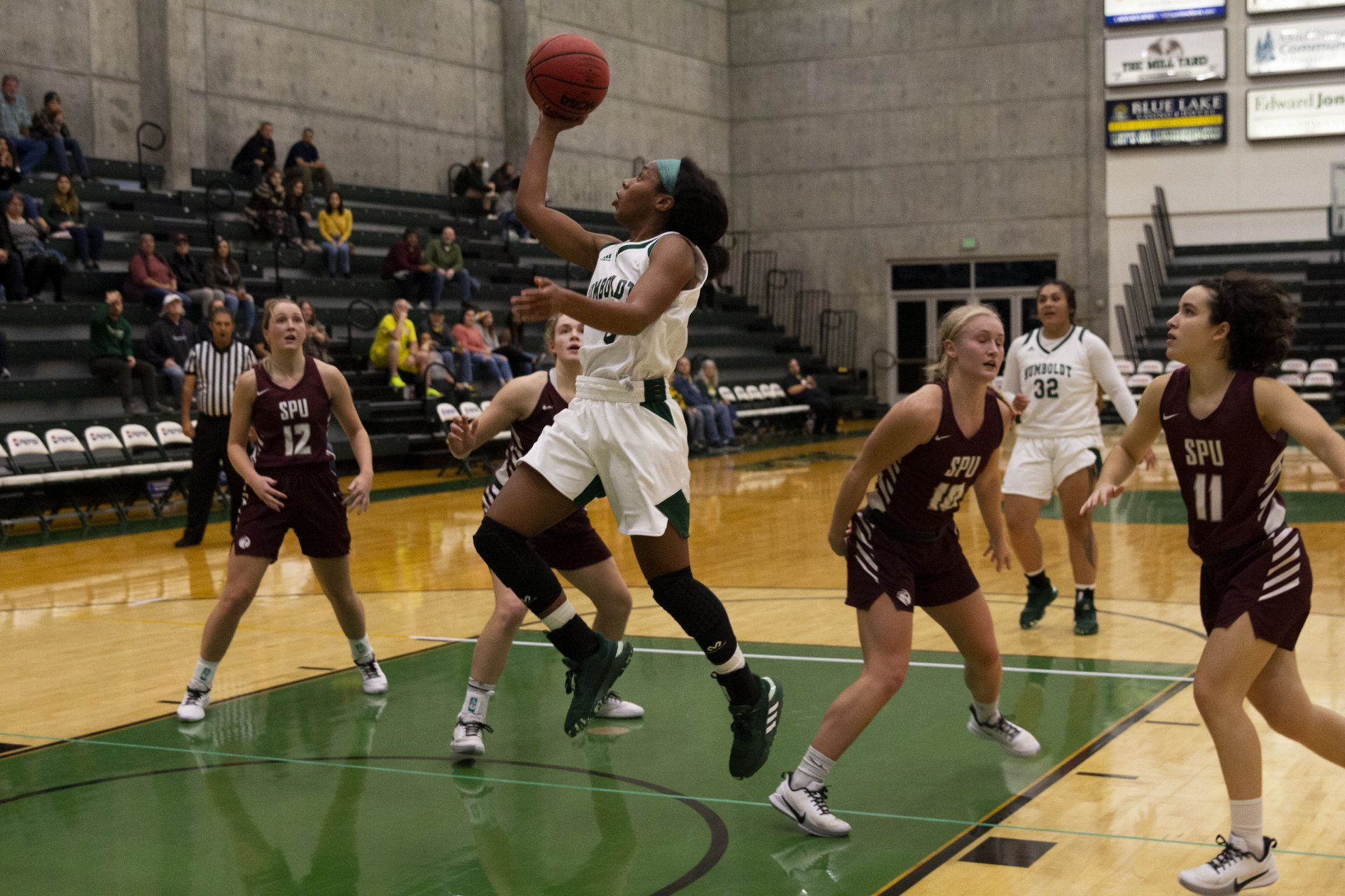 Humboldt State's Tyra Turner goes up for a layup after cutting through Seattle Pacific's defense during the first half of the game at Lumberjack Arena on Nov. 8. | Photo by Thomas Lal