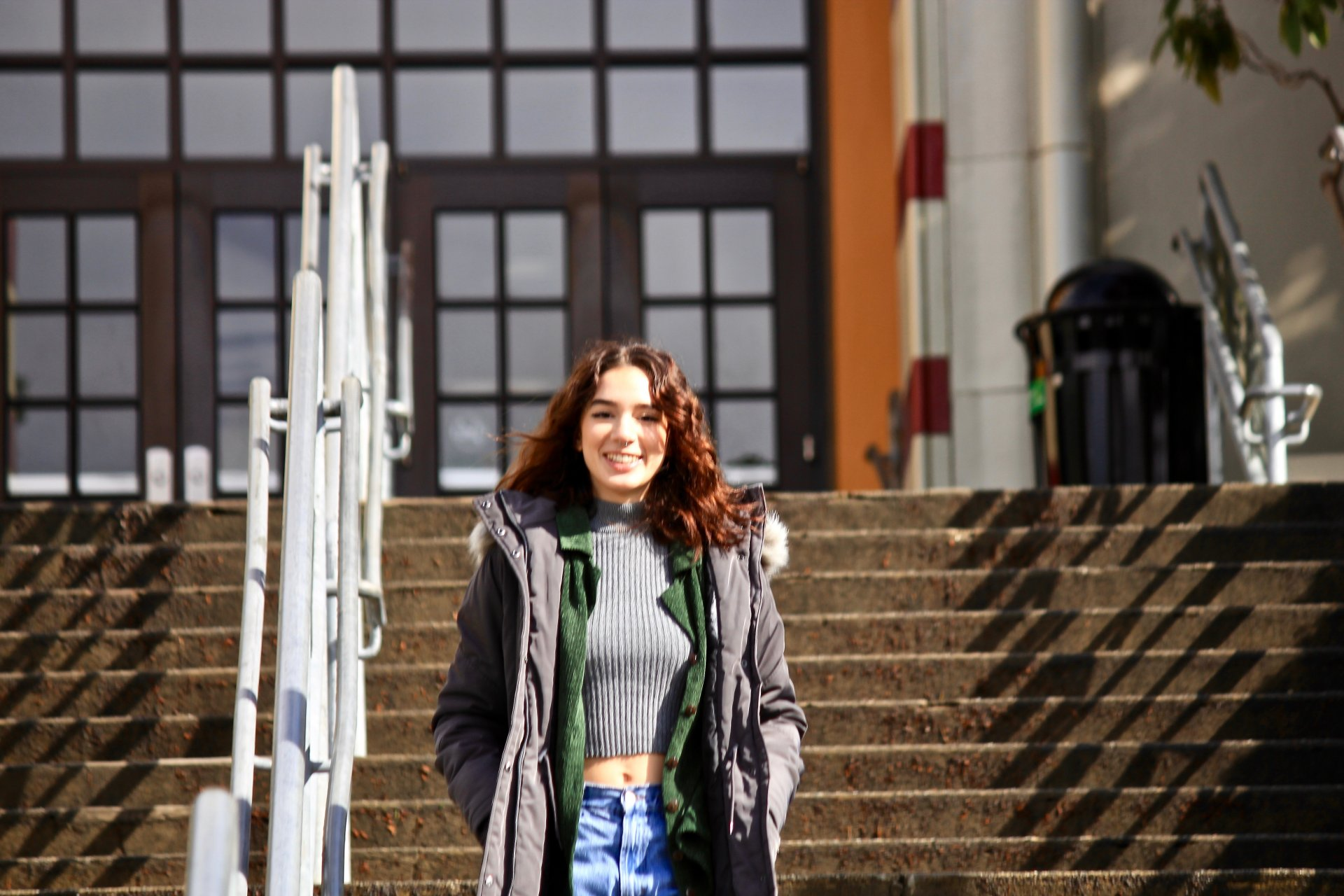 Isabel Duplantier, a freshman journalism major, walks down the steps in front of Founder's Hall on Feb. 15.  | Photo by Freddy Brewster