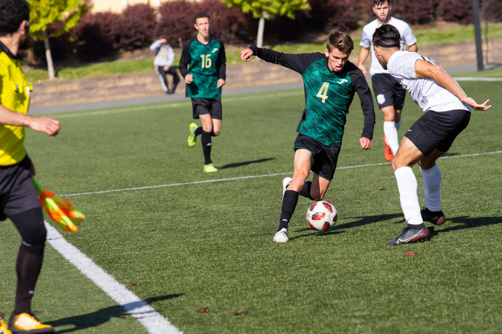 Humboldt State forward Devin Hauenstein battles for possession in the second half for the match against Cal State LA Nov. 9. | Photo by Thomas Lal
