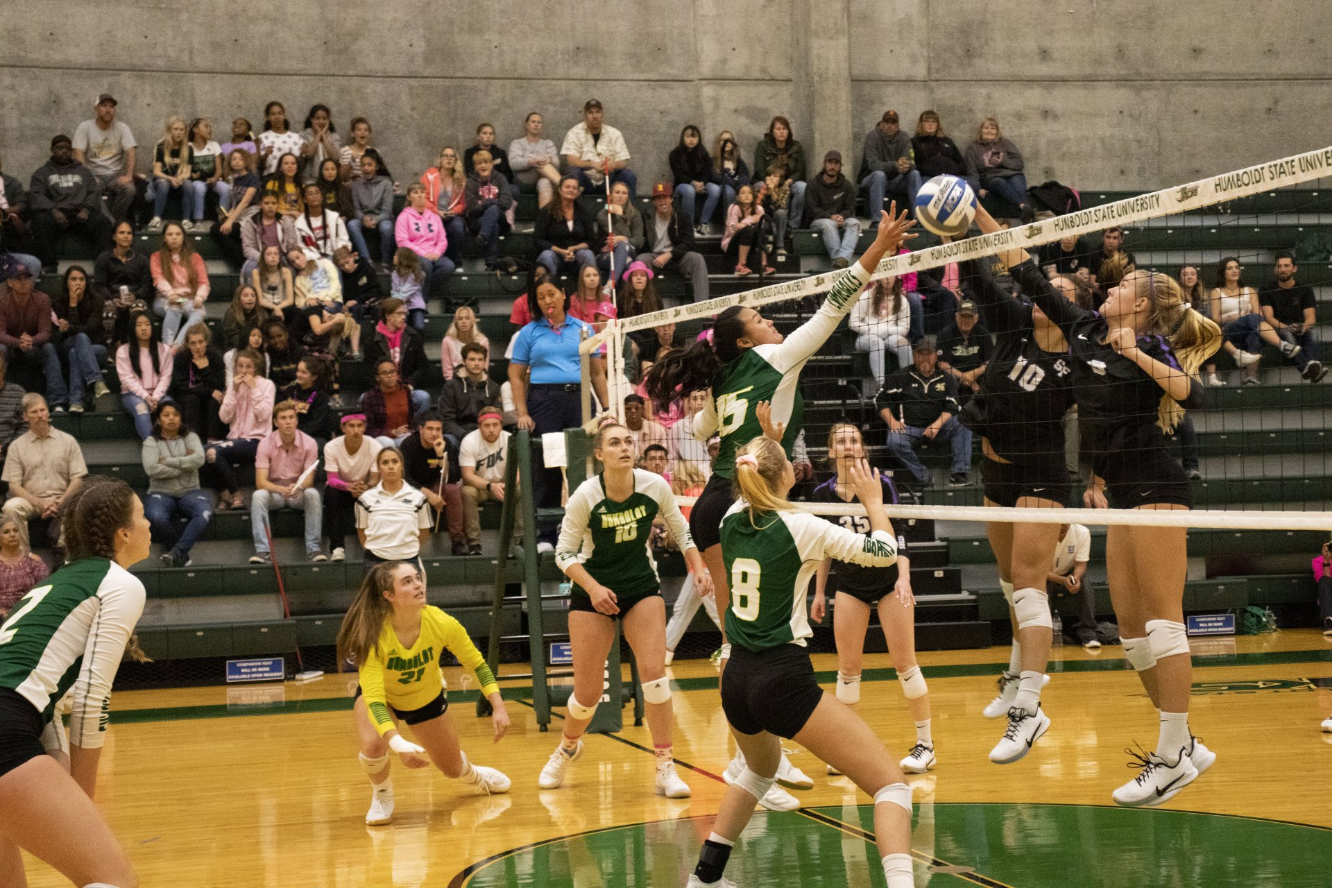 Outside hitter Malia Coyle hits the ball over the net toward San Francisco State during their Oct. 12 match on Dig Pink night at Lumberjack Arena.   Photo by Thomas Lal