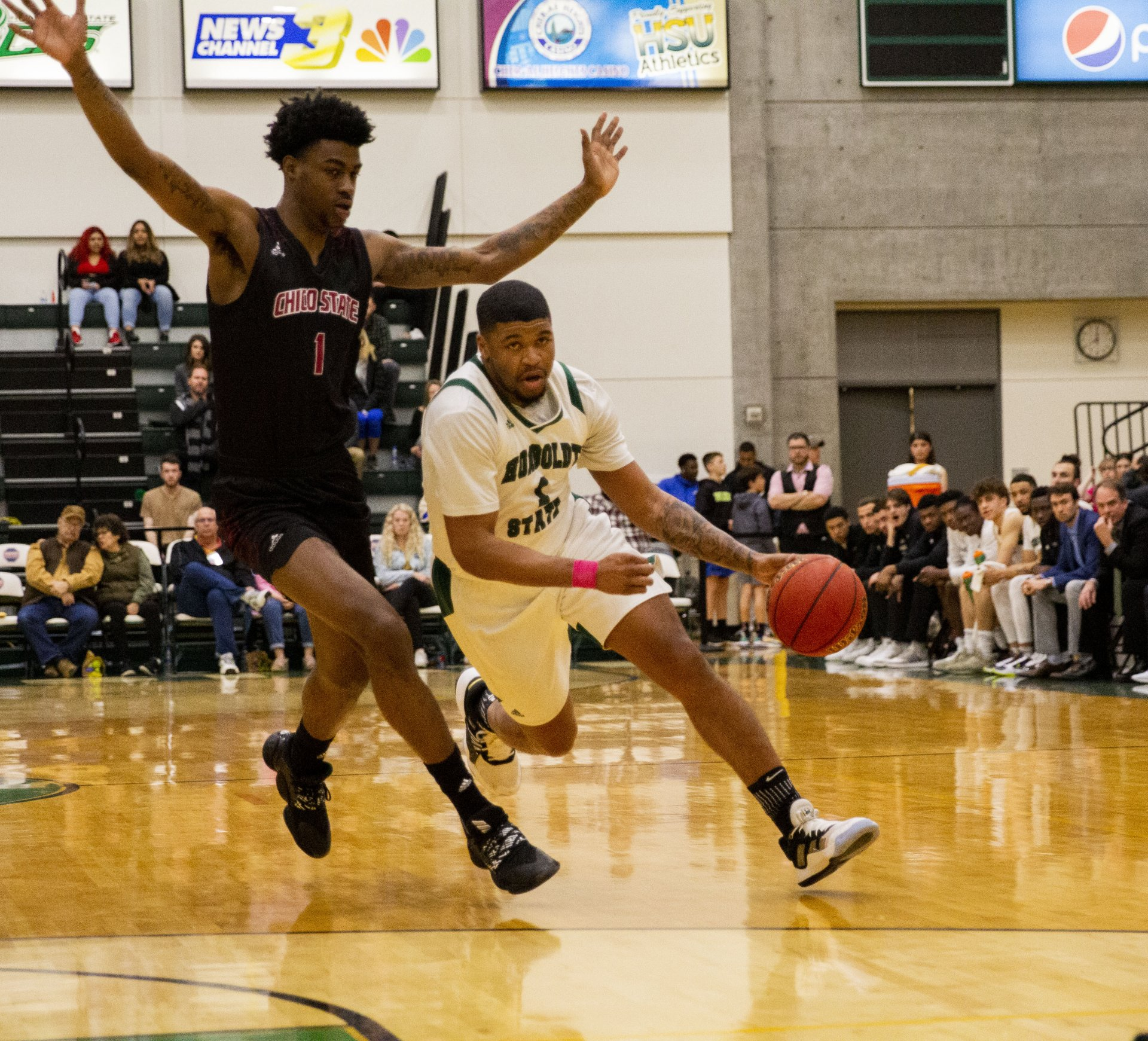 Senior guard Rob Lewis drives toward the basket against Chico State during Humboldt State's game at Lumberjack Arena on Feb. 27 | Photo by Thomas Lal