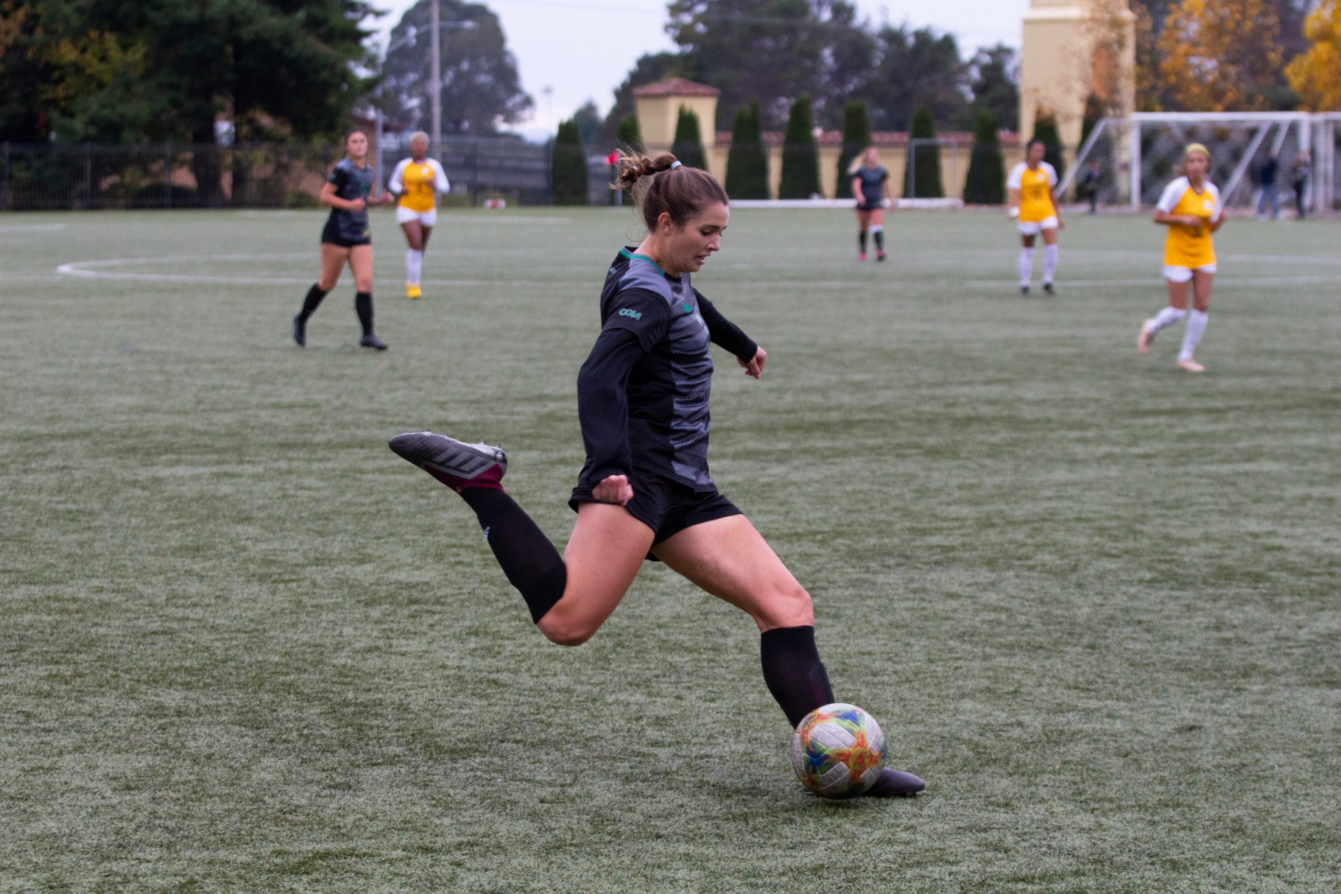 Humboldt State's Rose Harman kicks the ball up the field during the first half of the Jacks' match against Cal State LA at College Creek Field on Nov. 9. | Photo by Thomas Lal