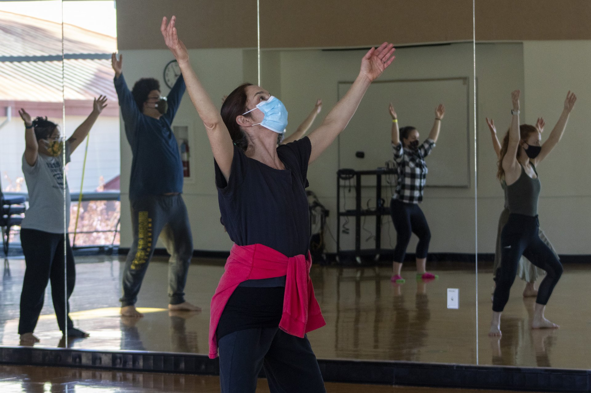 Professor Jandy M Bergmann leads the routine for her modern contemporary dance class on April 12, in preparation for their virtual performance in this year's spring concert. | Photo by Dakota Cox