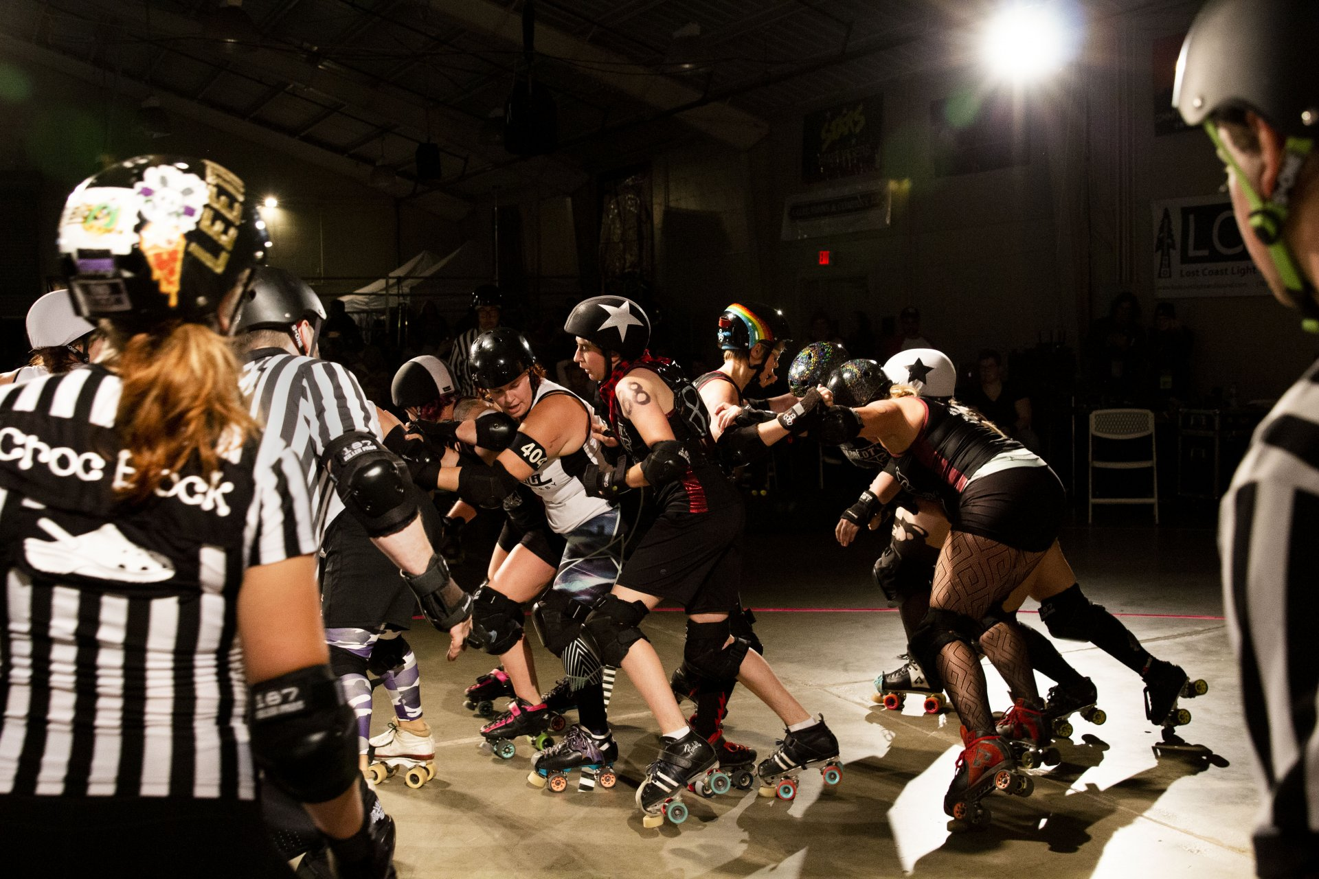 Root Force jammer Ossifrage (88) makes her way though the Shasta Roller Derby's blockers on the way to a scoring pass in the first second bout of a doubleheader on Sept. 28 at Redwood Acres Fairgrounds. | Photo by Thomas Lal