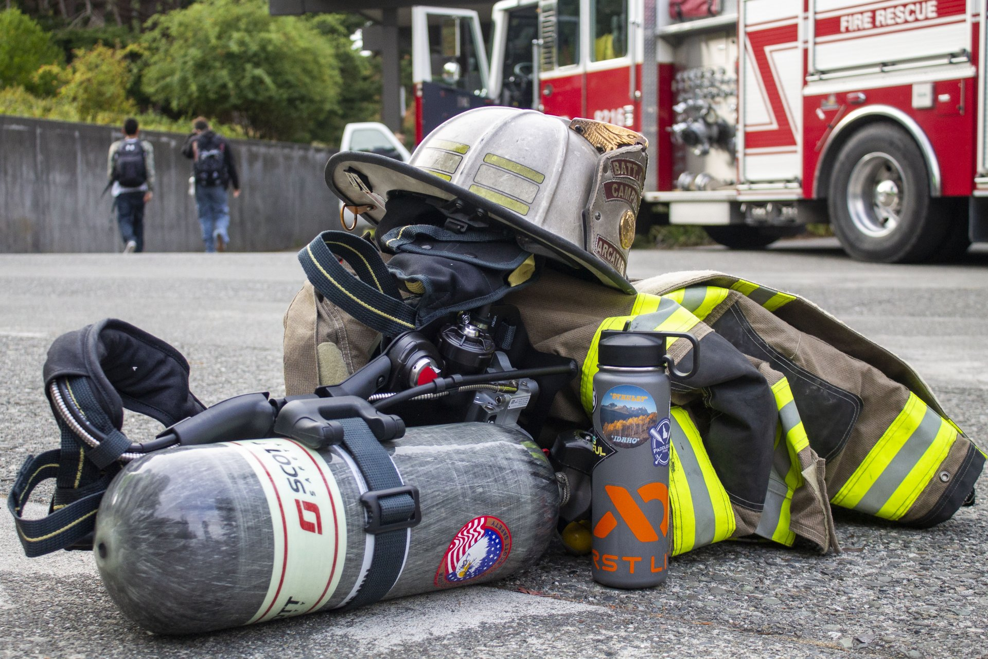 Arcata Fire Disctrict Battalion Chief Sean Campbell's gear and water bottle sit by the base of the Founders Hall stairs on Spetember 11 as Arcata Fire Department prepares to walk 20 flights of stairs in memory of those who lost their lives at the World Trade center.