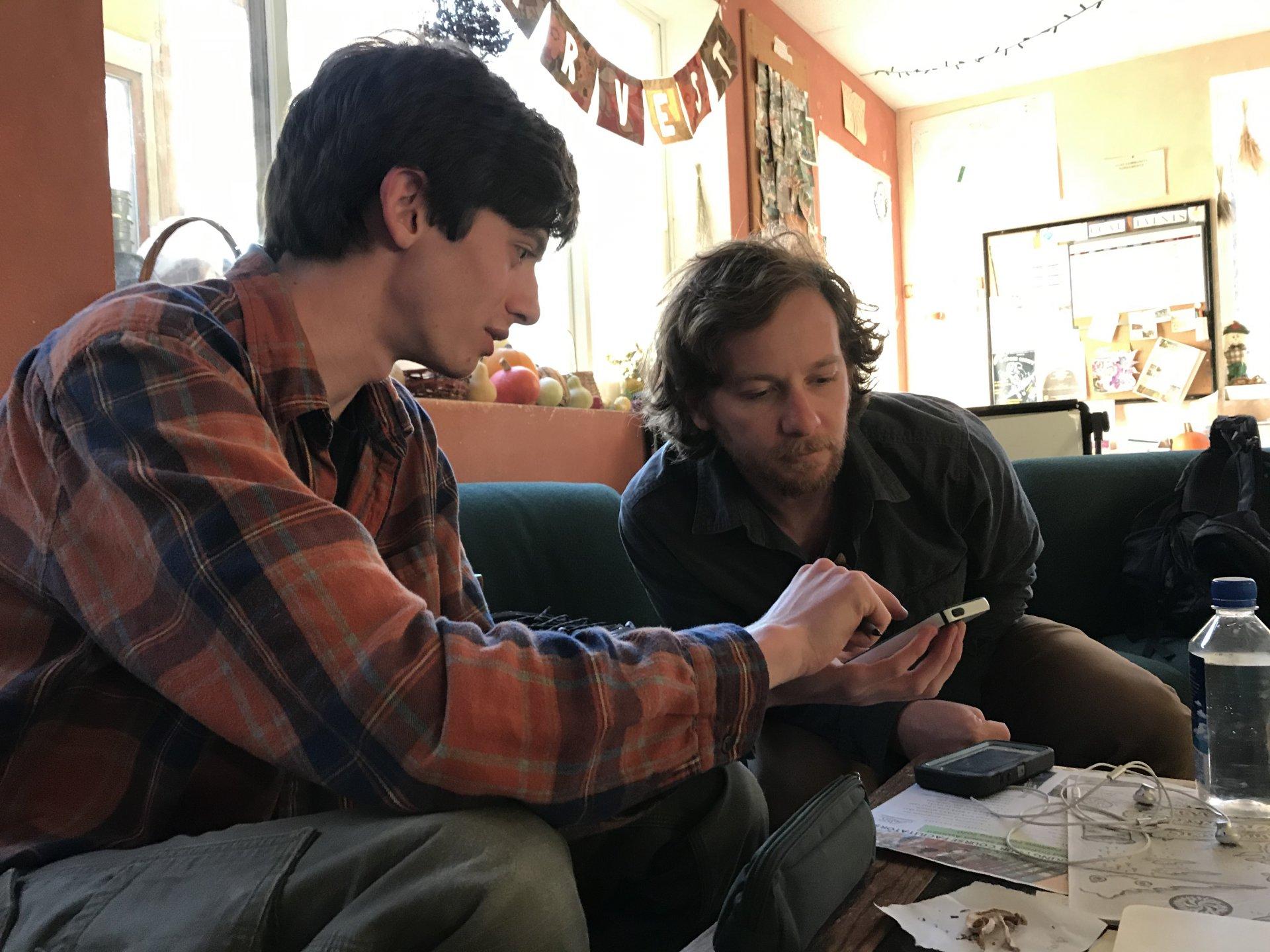 Lucas Burton and Caleb Von Rossum work on tying their iNaturalist posts with their specimens. | Photo by Collin Slavey