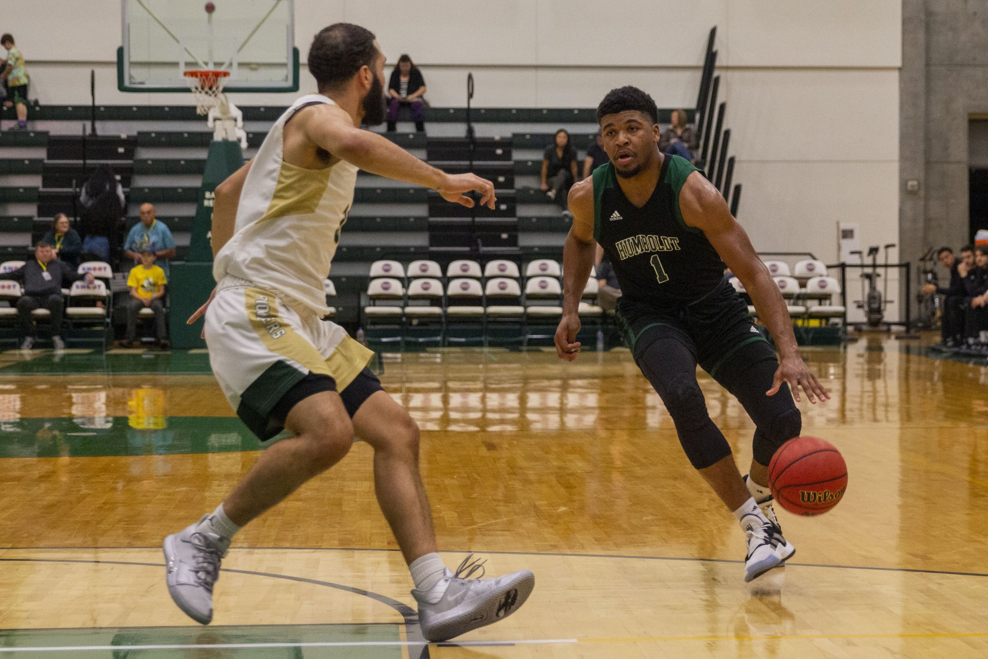 Humboldt State senior Rob Lewis drives the ball up the court during the first half of the Jacks' game against Pacific Union at Lumberjack Arena on Nov. 16. | Photo by Thomas Lal