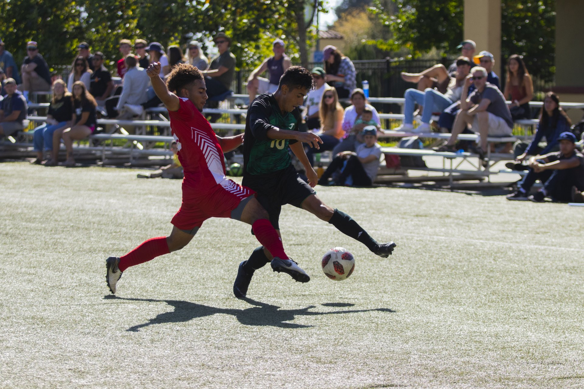 Humboldt State midfielder Israel Gonzalez is challenged by Stanislaus defenseman Carlos Amaya while attacking in the offensive zone during their match on Oct. 6 at College Creek Field. | Photo by Thomas Lal
