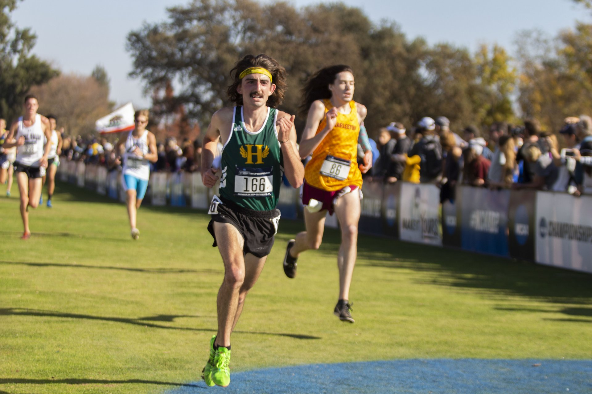 Humboldt State senior Daniel Tull surges toward the finish line for a 56th place result at the NCAA Division II Cross Country Championship at Arcade Creek Cross Country Course in Sacramento on November 23. | Photo by Thomas Lal
