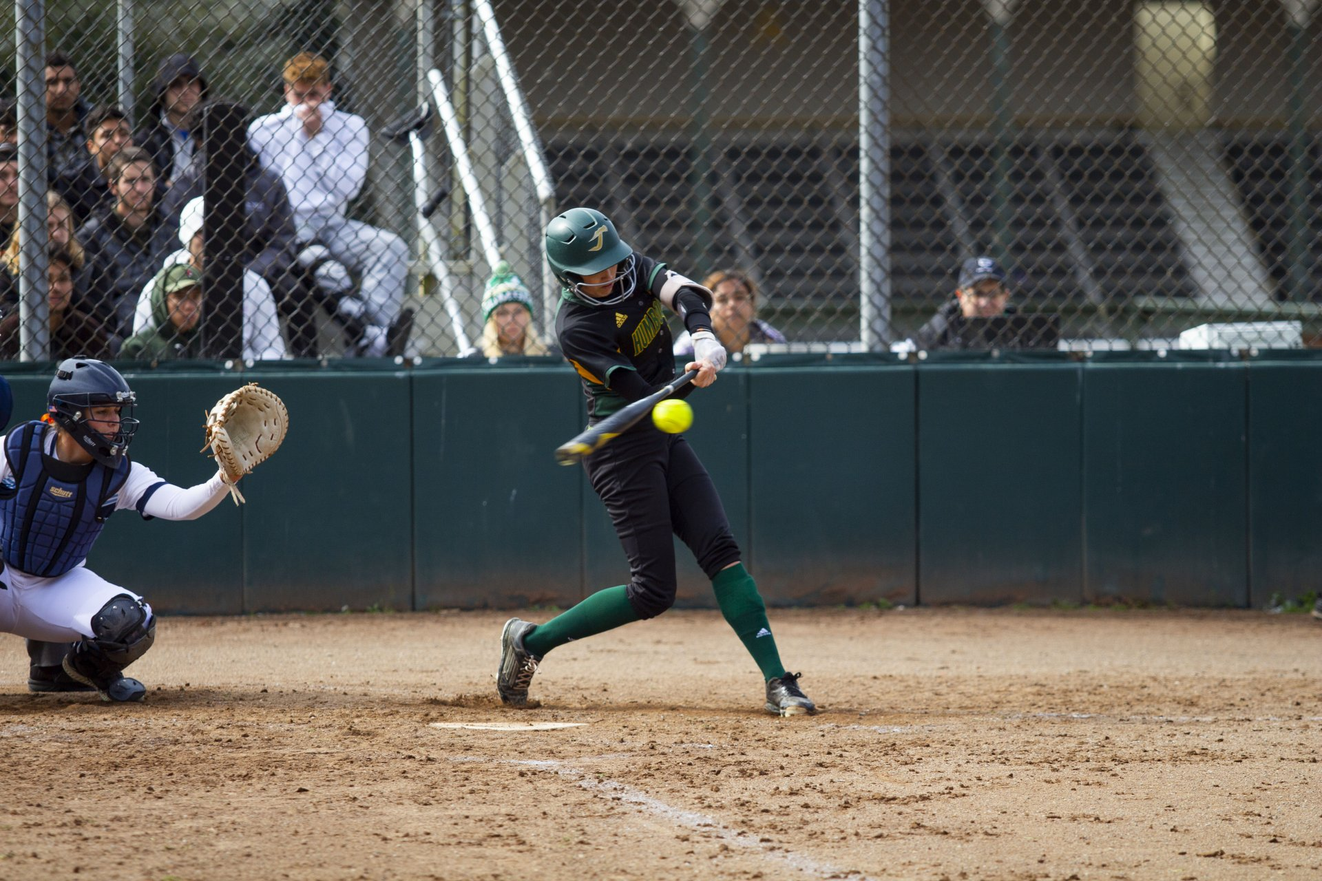 Humboldt State outfielder Lauren Lipe takes a swing at a pitch during the Lumberjacks' second game of a doubleheader against Sonoma State on Feb. 29 at HSU Softball Field. | Photo by Thomas Lal