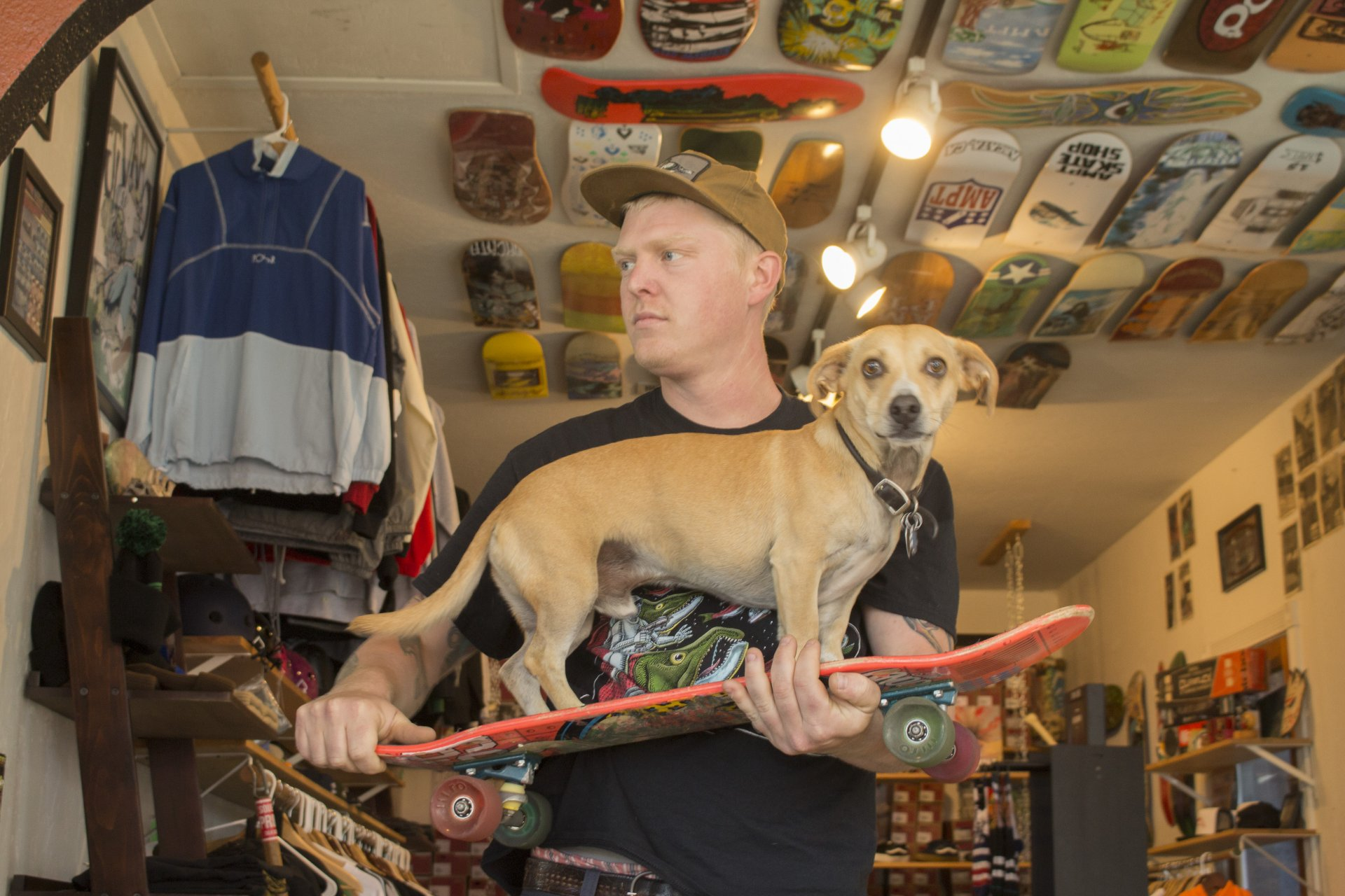 AMPT skate shop owner Derek Russell and his dog Cosmo in their store in Arcata, CA. | Photo by Sean Bendon