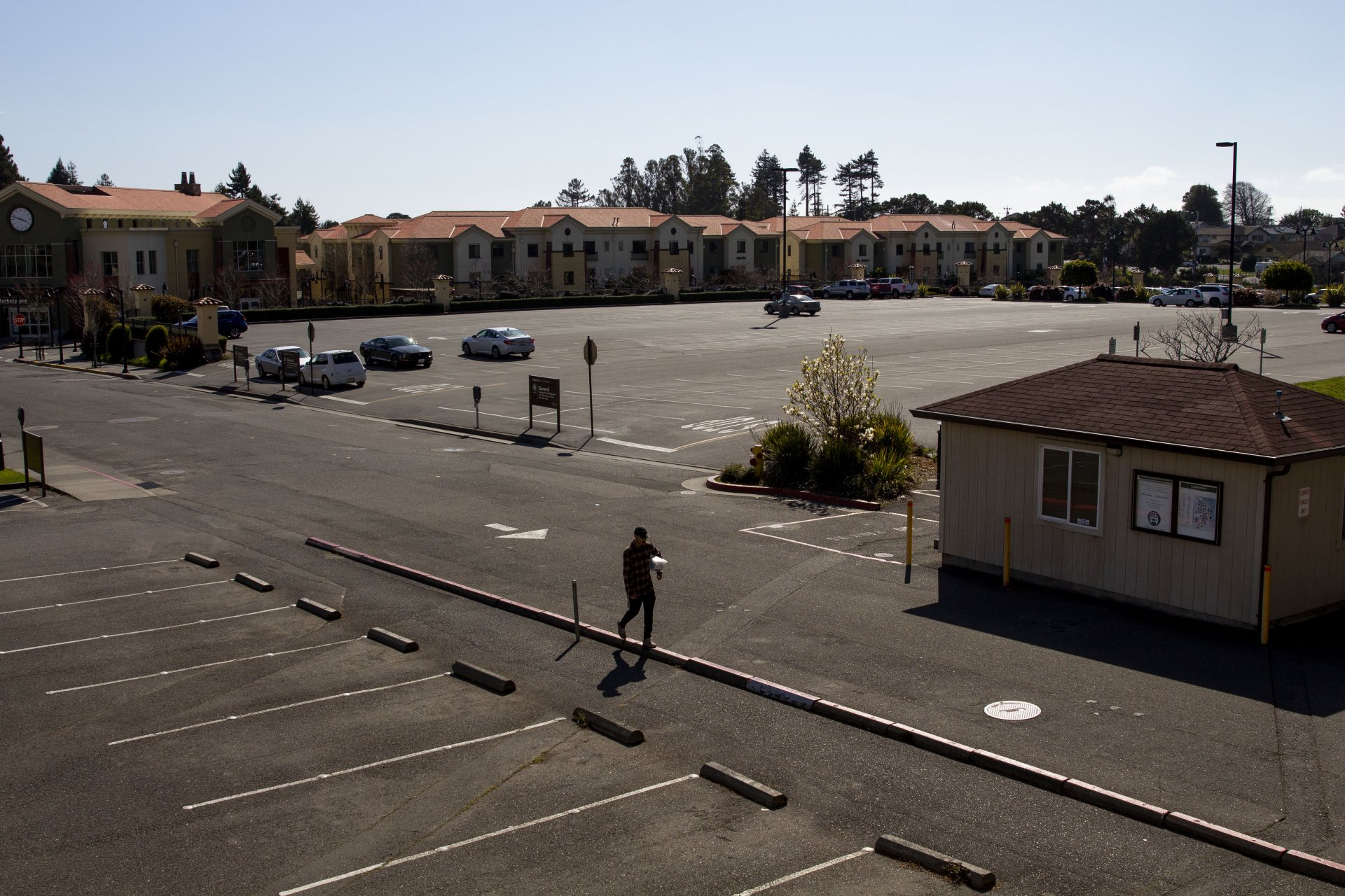 A lone person walks through the mostly empty parking lots at Humboldt State University on the first weekend of the Humboldt County shelter in place order due to COVID-19 on March 21. | Photo by Thomas Lal