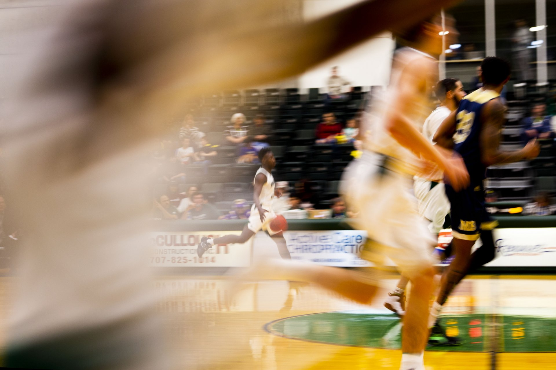 Humboldt State senior Leland Green moves the ball up the court during the first half of the Jacks' game against Monterey Bay at Lumberjack Arena on January 25. | Photo by Thomas Lal