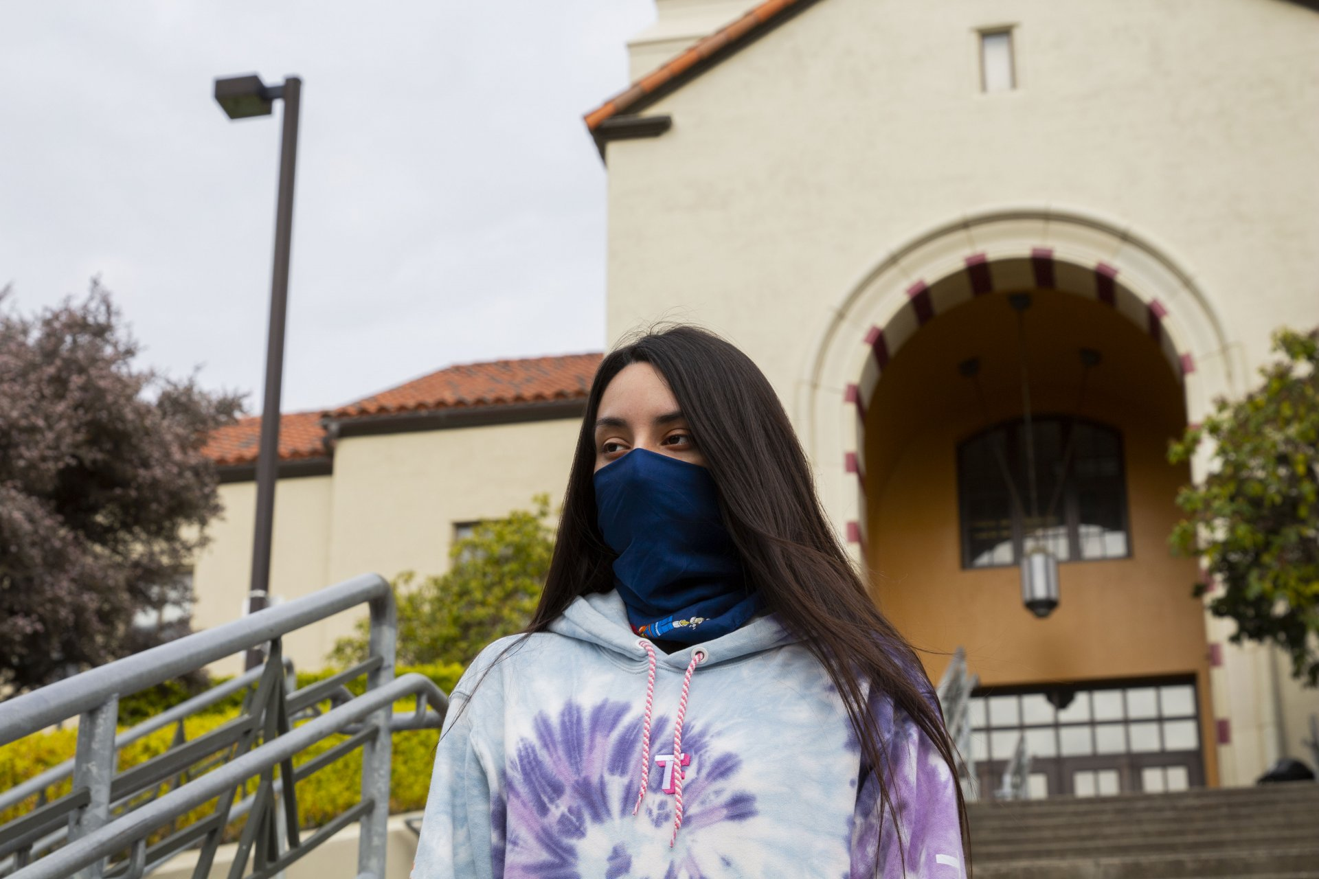 Junior criminology and justice major Samantha Bosch poses for a photo wearing her mask on the steps of Founders Hall April 20, 2020. | Photo by Thomas Lal