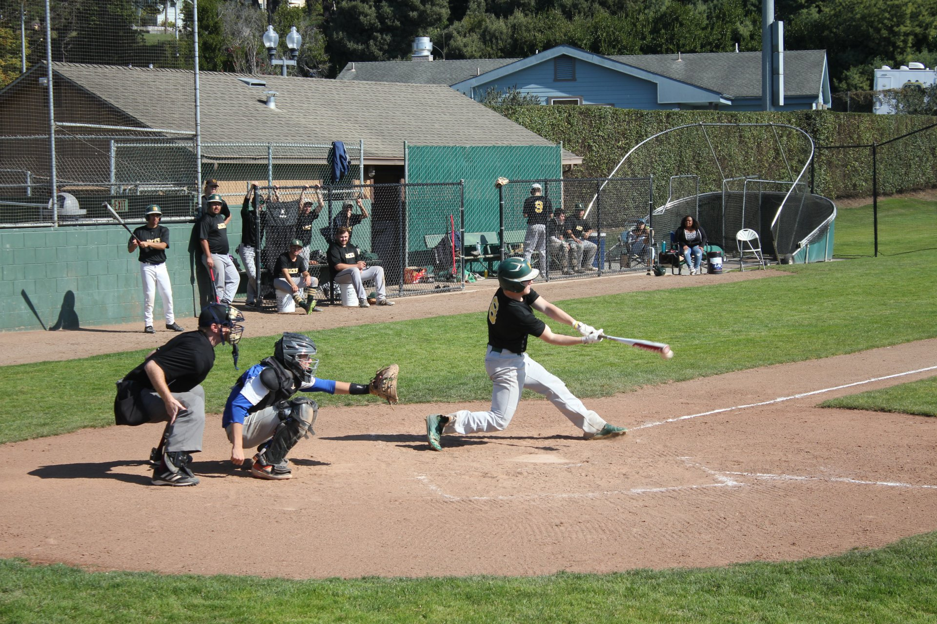 Hitter Willie Cestarollo strikes a fastball thrown by a Humboldt Eagles pitcher, at the Arcata Ballpark on Oct. 13. | Photo by Skye Kimya