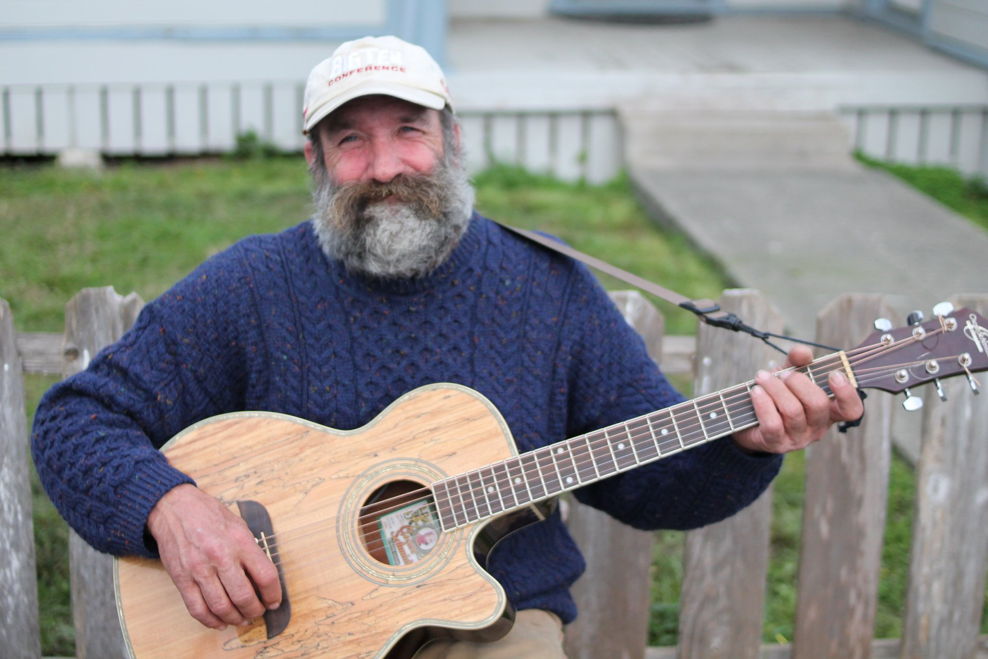 Ricky Smith, who has been homeless the past two years, plays guitar on the streets of Arcata. Photo by: T.William Wallin