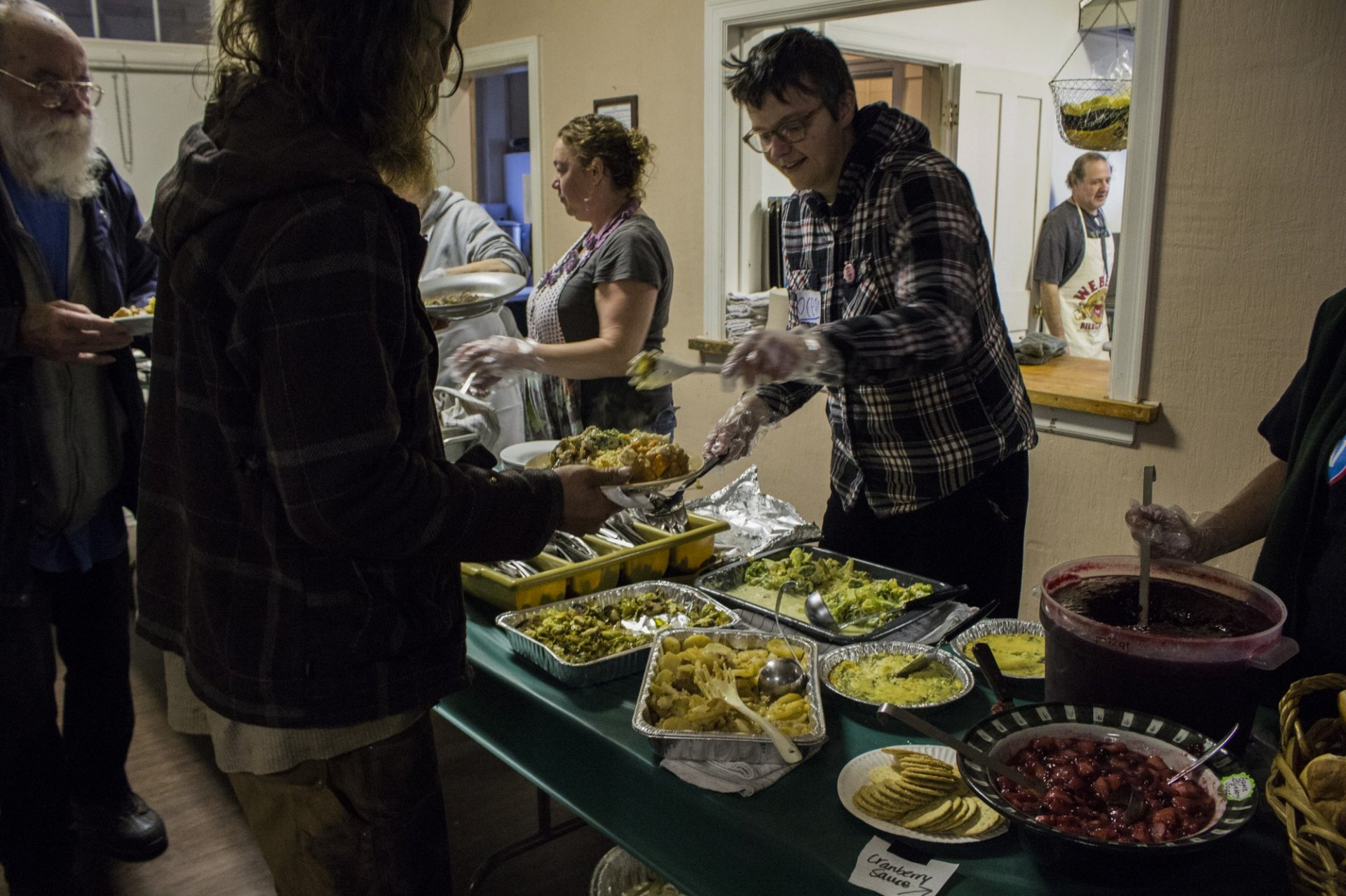 Volunteers serving free food to community memebrs for the 4th annual Harvest Feast held at The Veteran's Hall on Thanksgiving.|  Photo by Tony Wallin