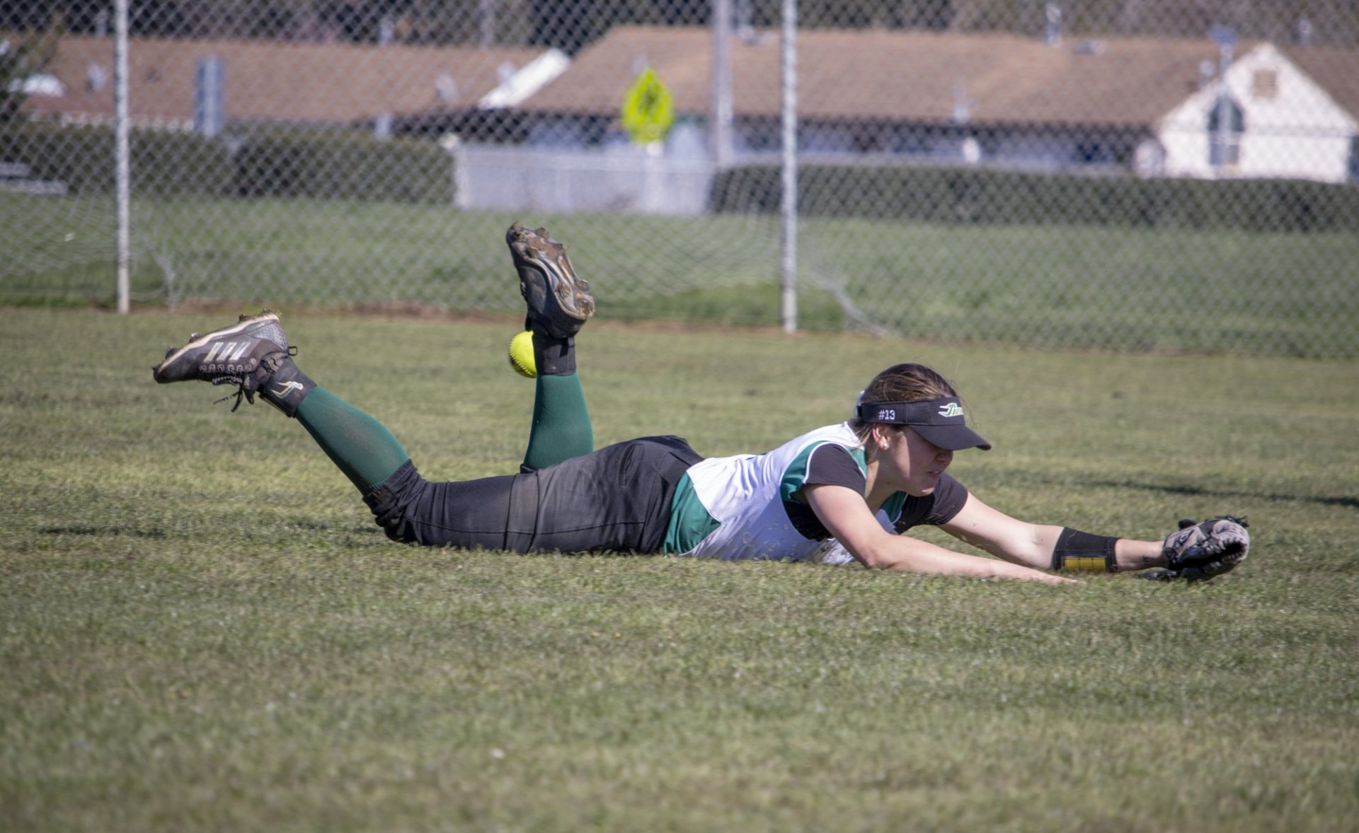Senior outfielder Illa Haley diving and missing a line drive Friday versus SF State. Photo credit: Matt Shiffler