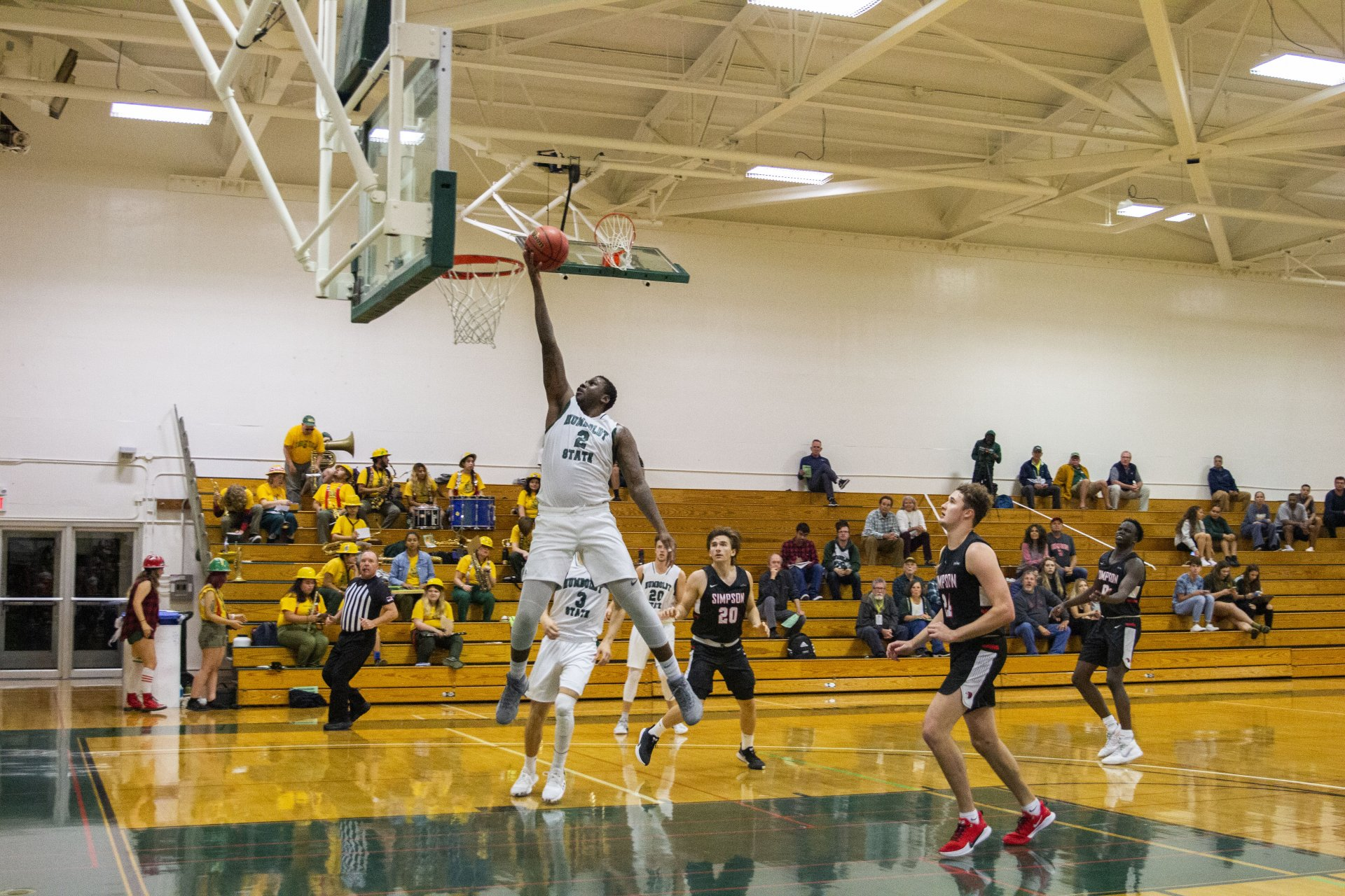 Humboldt State's Raysean Scott Jr. jumps up to dunk the ball during the men's basketball exhibition game against Simpson on October 25.