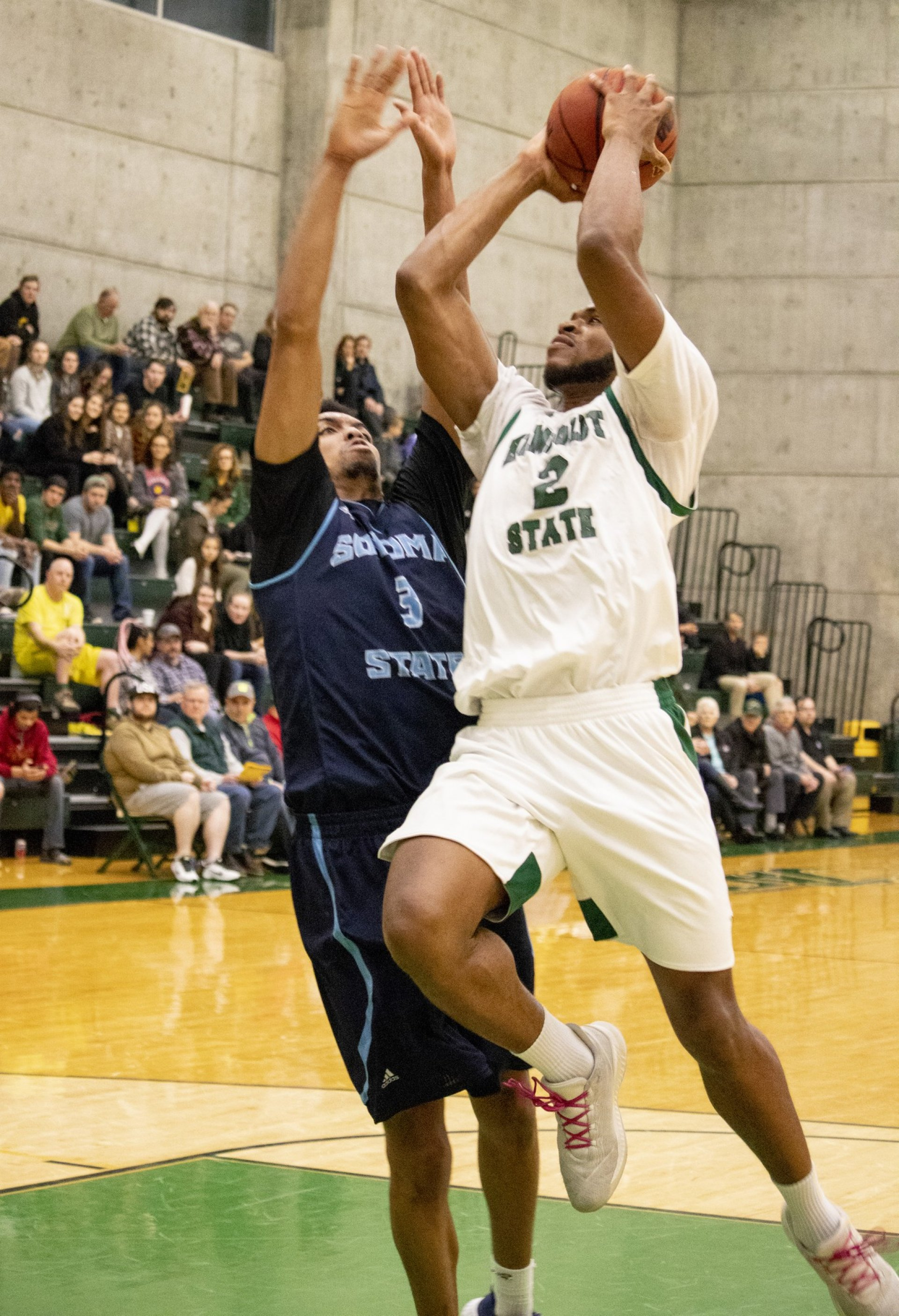 #2 Calvin Young II goes straight up against the Seawolves defender scoring two point with a layup.  | Photo by Matt Shiffler