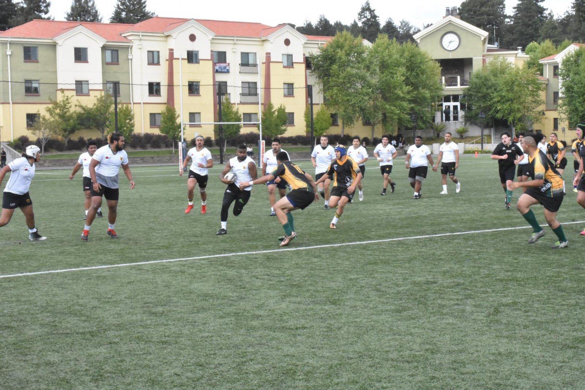 Freshman Junior Savu running into tackle in 2019 Alumni Game | Photo by Adonnis Lee-Johnson