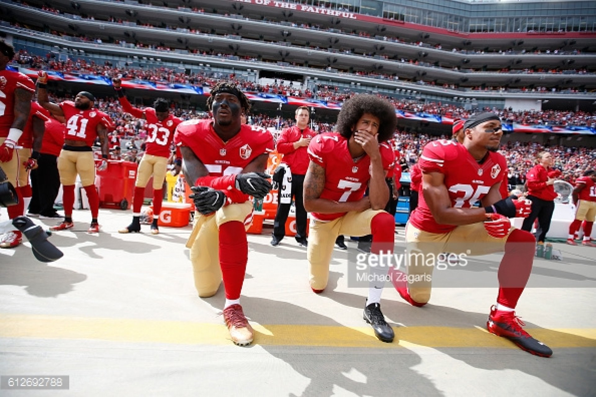 SANTA CLARA, CA - OCTOBER 2: Antoine Bethea #41 and Rashard Robinson #33  of the San Francisco 49ers raise their first during the anthem as Eli Harold #58 while teammates Colin Kaepernick #7 and Eric Reid #35 take a knee, prior to the game against the Dallas Cowboys at Levi Stadium on October 2, 2016 in Santa Clara, California. The Cowboys defeated the 49ers 24-17. (Photo by Michael Zagaris/San Francisco 49ers/Getty Images)  *** Local Caption *** Antoine Bethea;Rashard Robinson;Eli Harold;Colin Kaepernick;Eric Reid