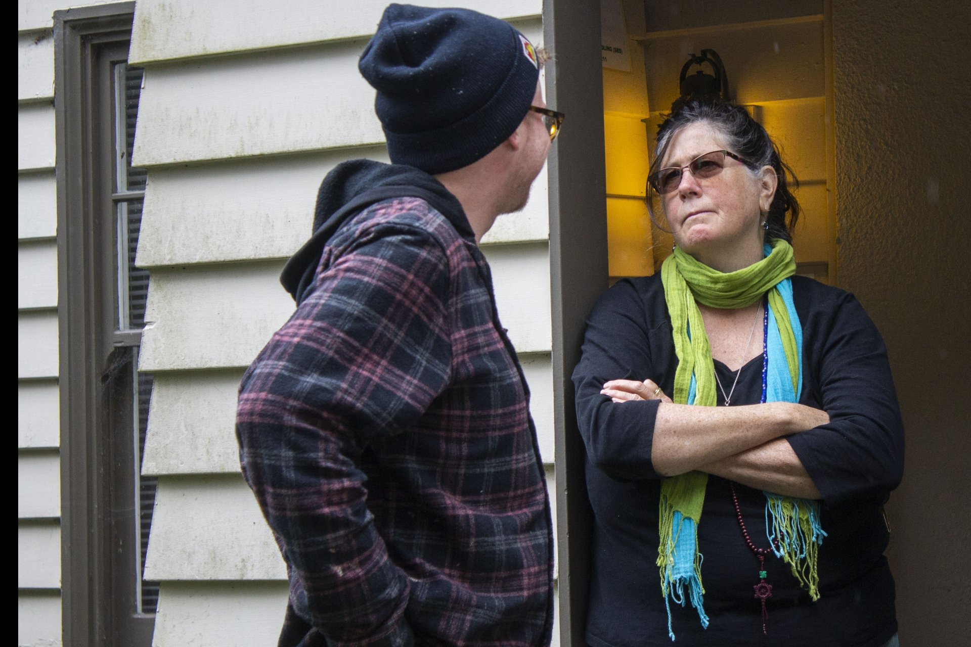Danielle Orr who has volunteered at KHSU for 39 years talks with former paid intern Damien Jimenez outside of Feuerwerker House where the KHSU station has been based on the HSU campus on April 11, 2019. | Photo by Thomas Lal