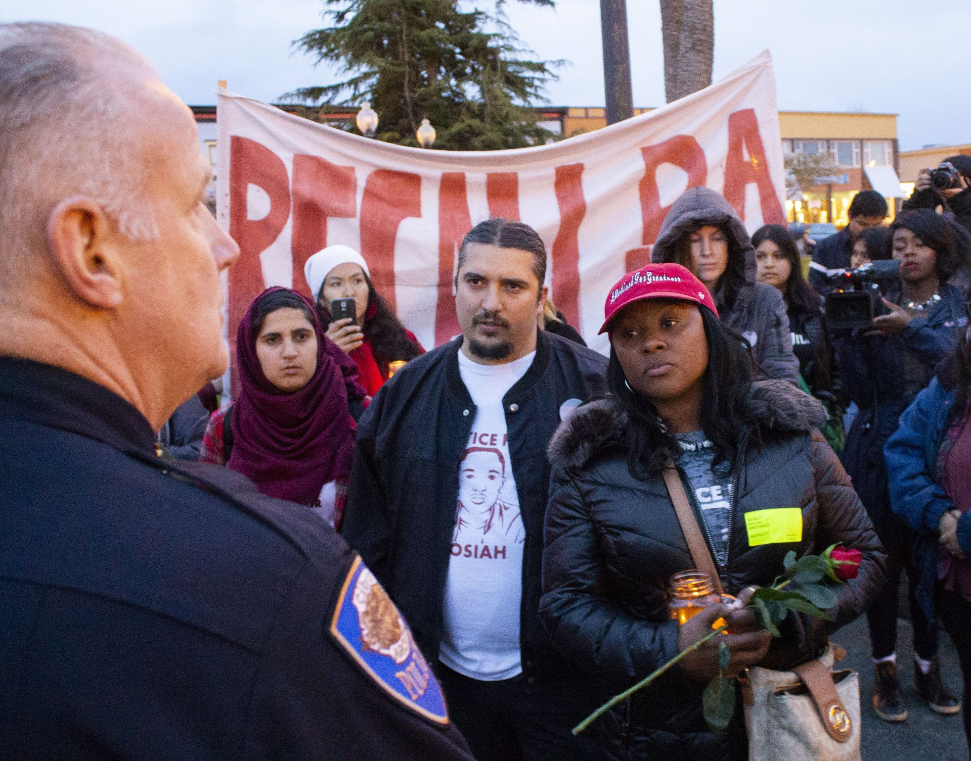 Charmaine Lawson and her supporters confront Arcata police chief Brian Ahearn following a demonstration on the two year anniversary of her son David Josiah Lawson's death on the Arcata Plaza on April 15. | Photo by Thomas Lal