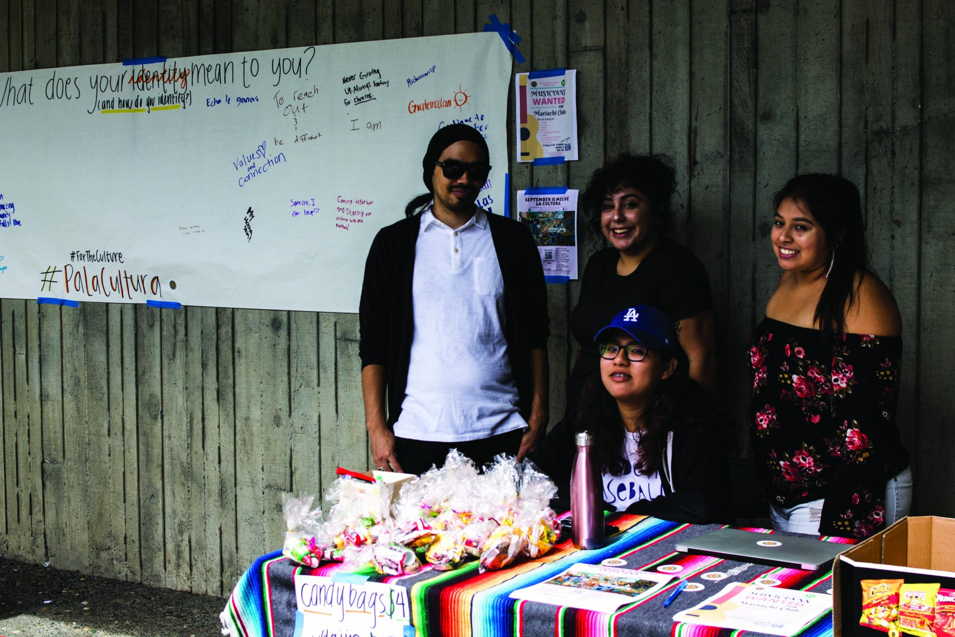 (Photo by Tony Willan)  Members from the Latinx Center for Academic Excellence spread awareness of Mes De La Cultura on Aug. 29 in front of the Depot.