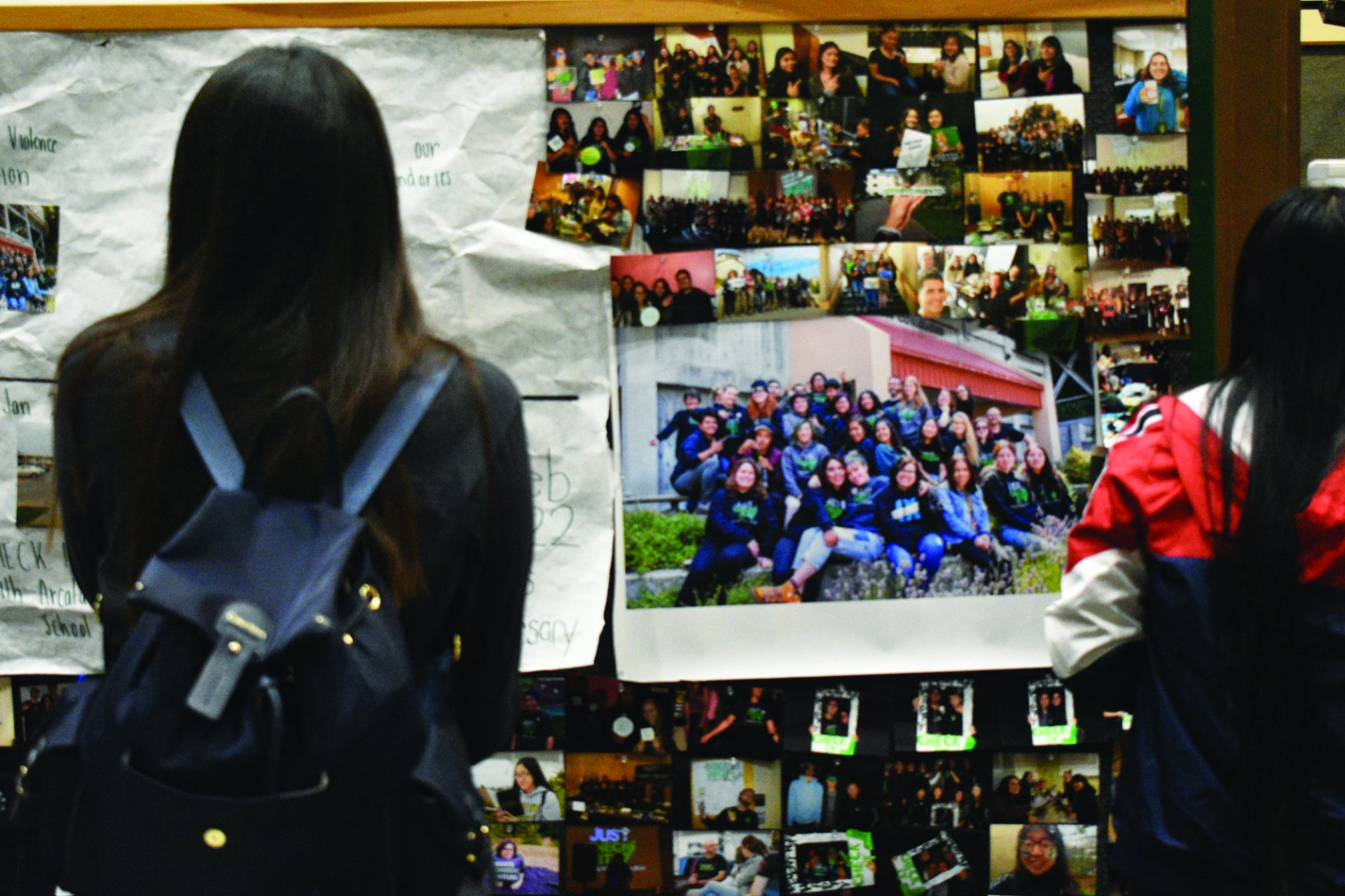 Students passed by a timeline of Check It's progress and accomplishment over the years. Feb. 23. | Photo by Grace Caswell