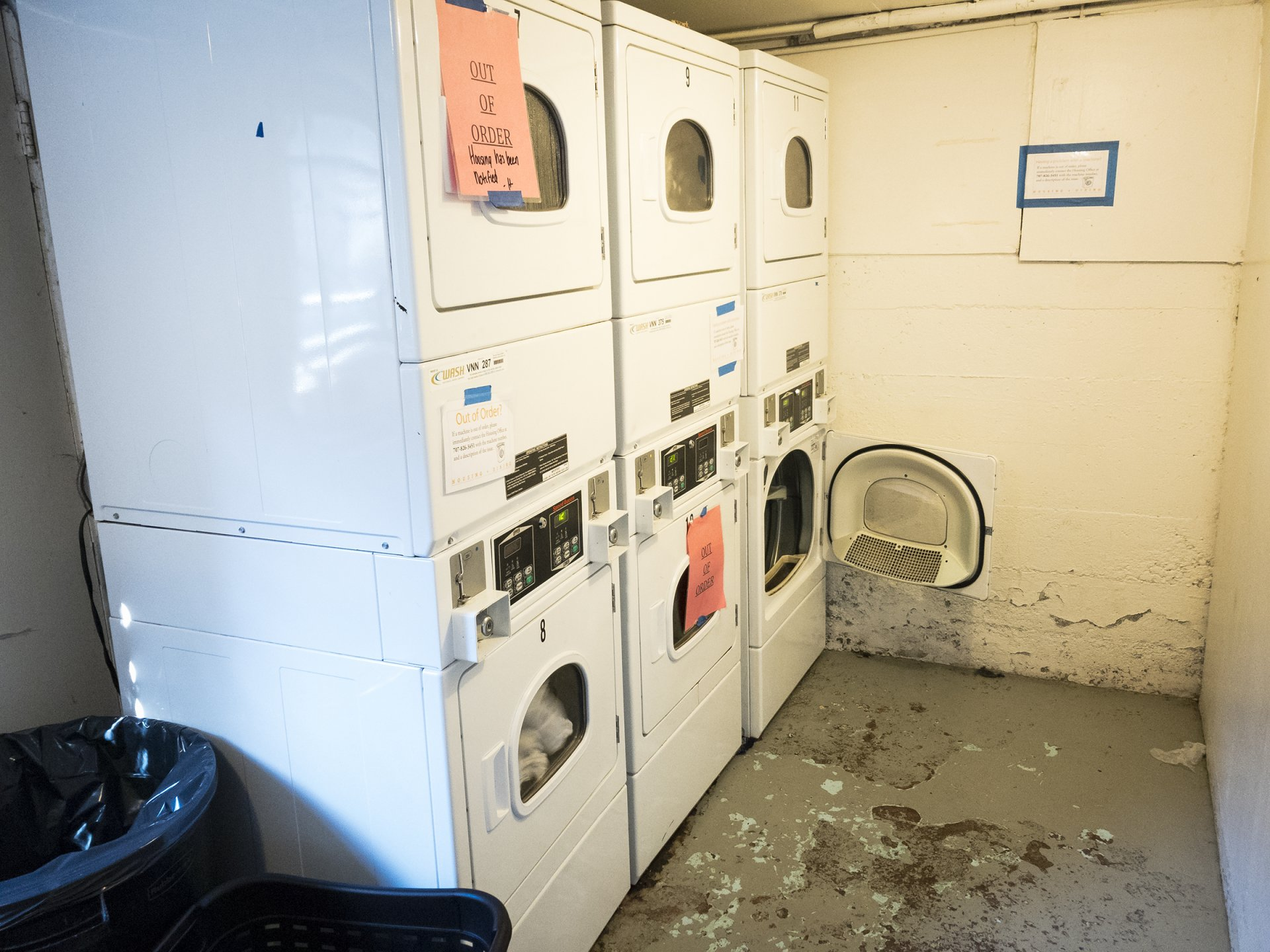 Dryers out of order in the Campus Apartments laundry room, Feb. 2. Photo by Luis Lopez.
