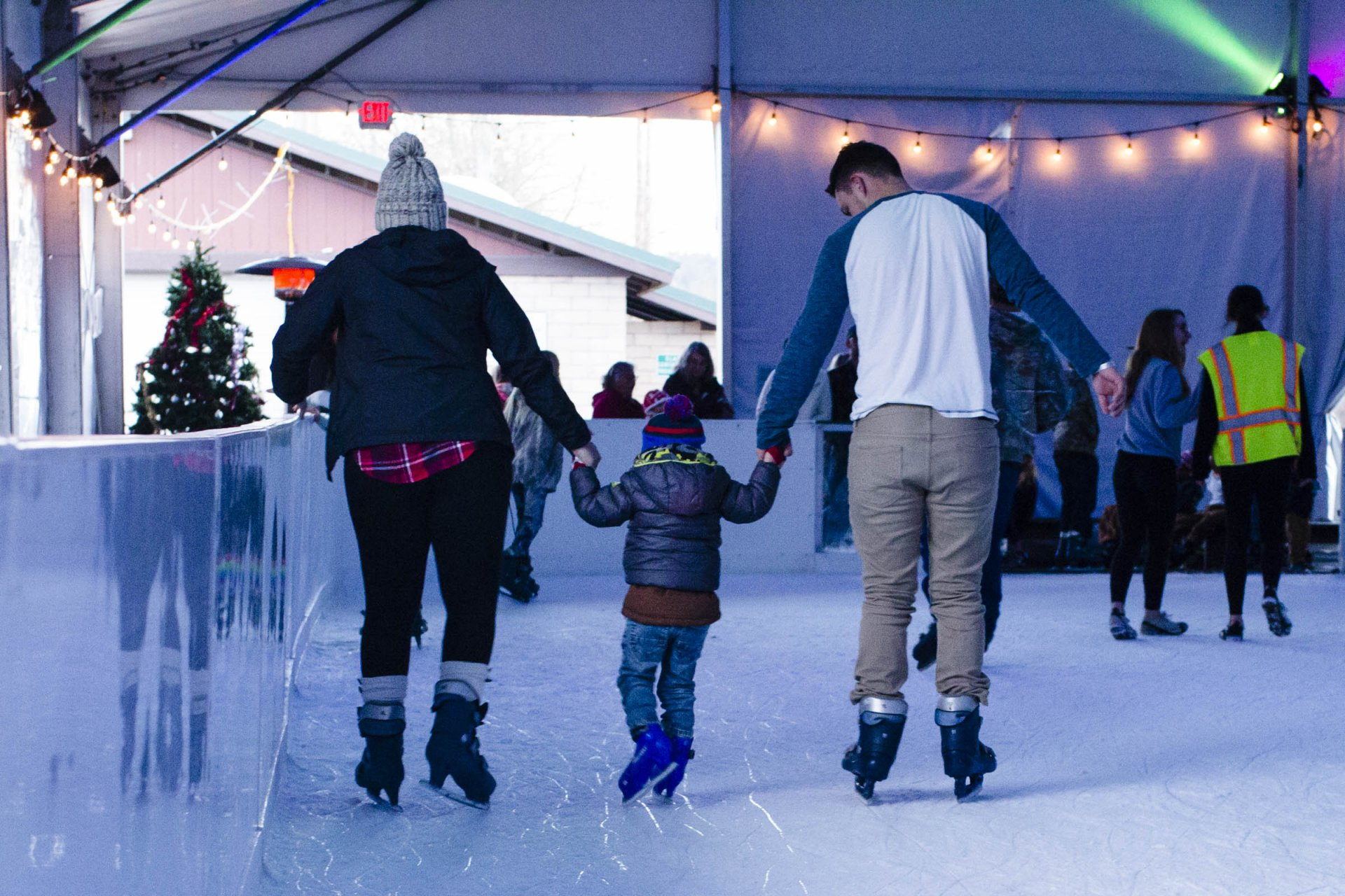 A couple holds their boy as they skate around the ice rink in Newburg Park. Photo by Lauren Shea