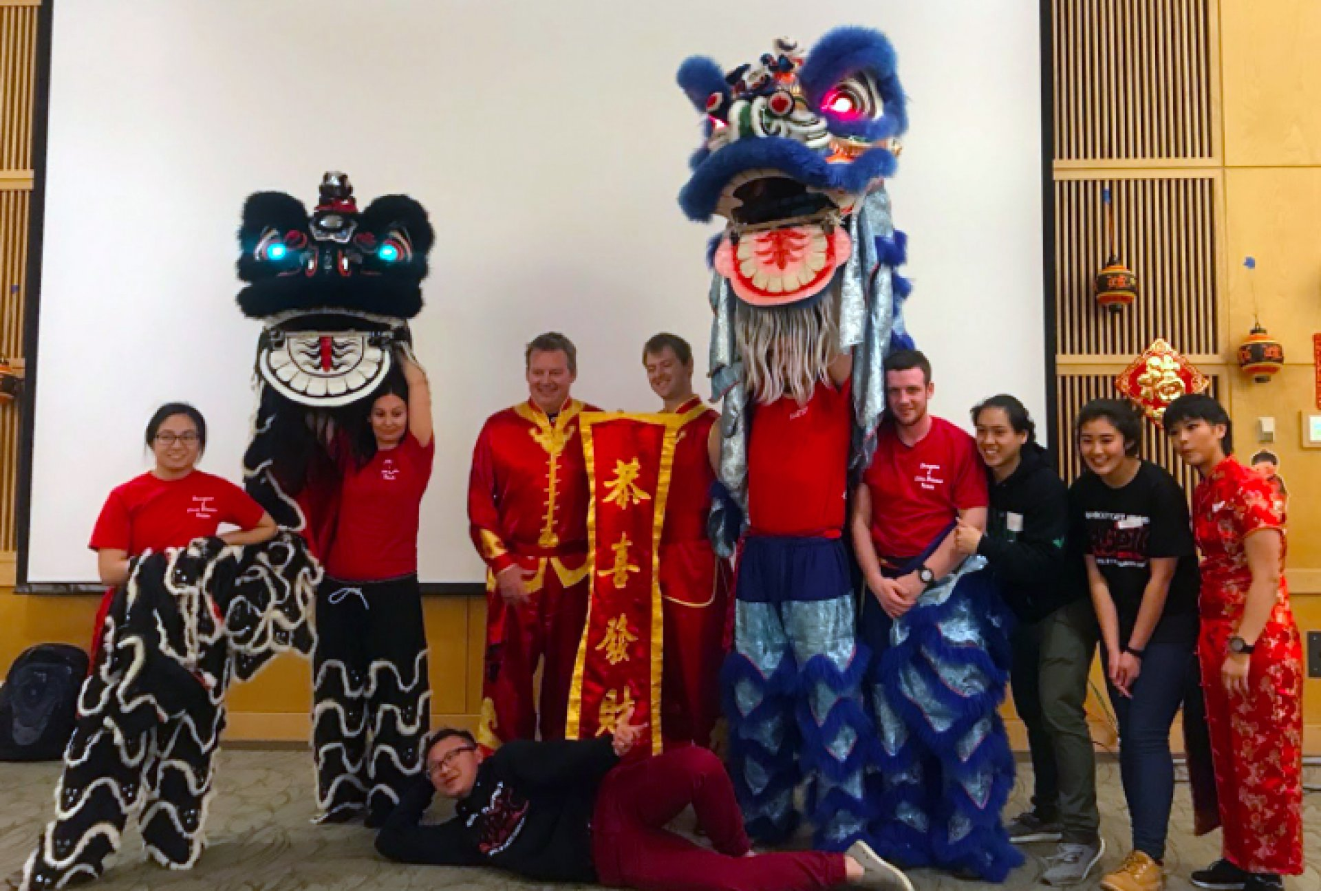 Lunar New Year performers, instructors and hosts gather to take pictures for their audience after the lion dance. Photo by Dajonea Robinson.