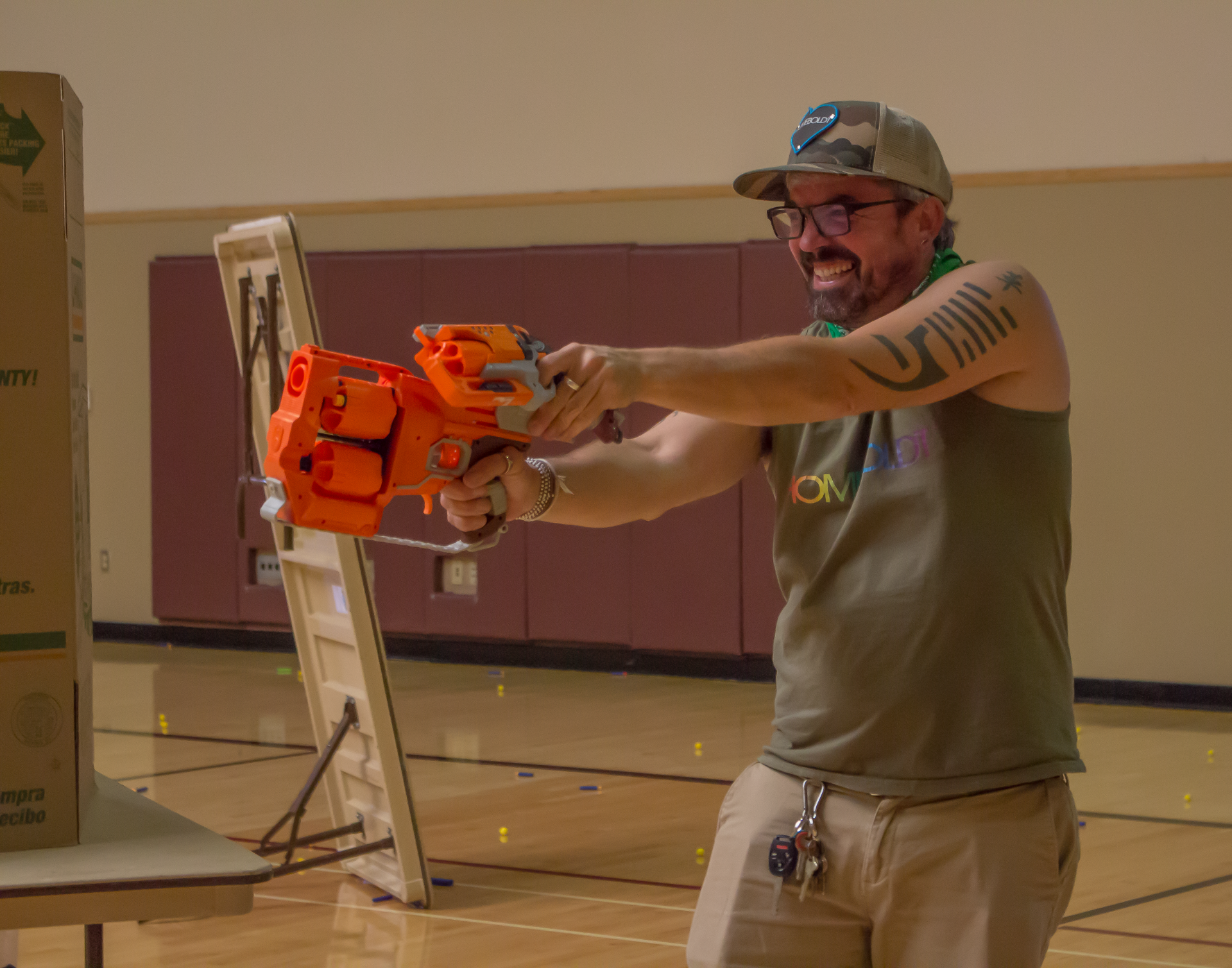 Trevor Hammons, counselor at Zane Middle School in Eureka, reloading midbattle during the Humboldt Nerf war at the Arcata Community Center. | Photo by Nick Kemper