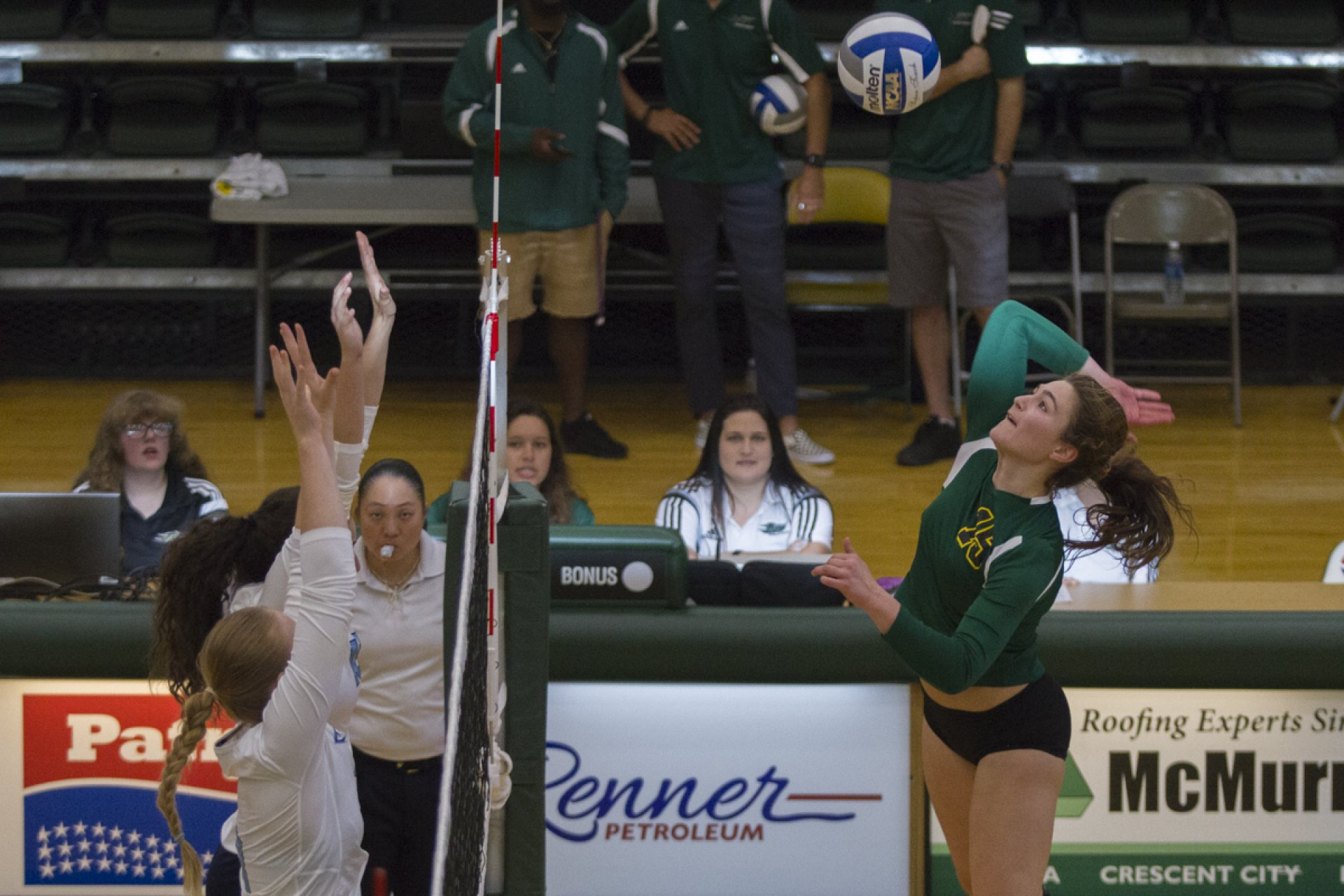 Humboldt State University outside hitter Selena Dutton, right, winds up in anticipation of a strike toward the Sonoma State University opposition during a loss in four sets on Friday. | Photo by Diego Linares