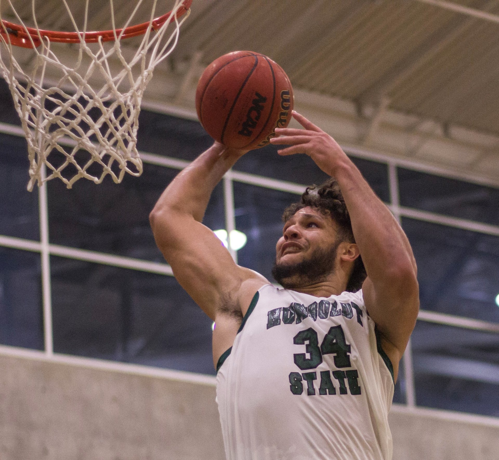 Davasyia Hagger takes a pass from a Humboldt State University teammate and elevates for a dunk in the 110-66 win over Pacific Union College on Nov. 13 in the Lumberjack Arena. | Diego Linares
