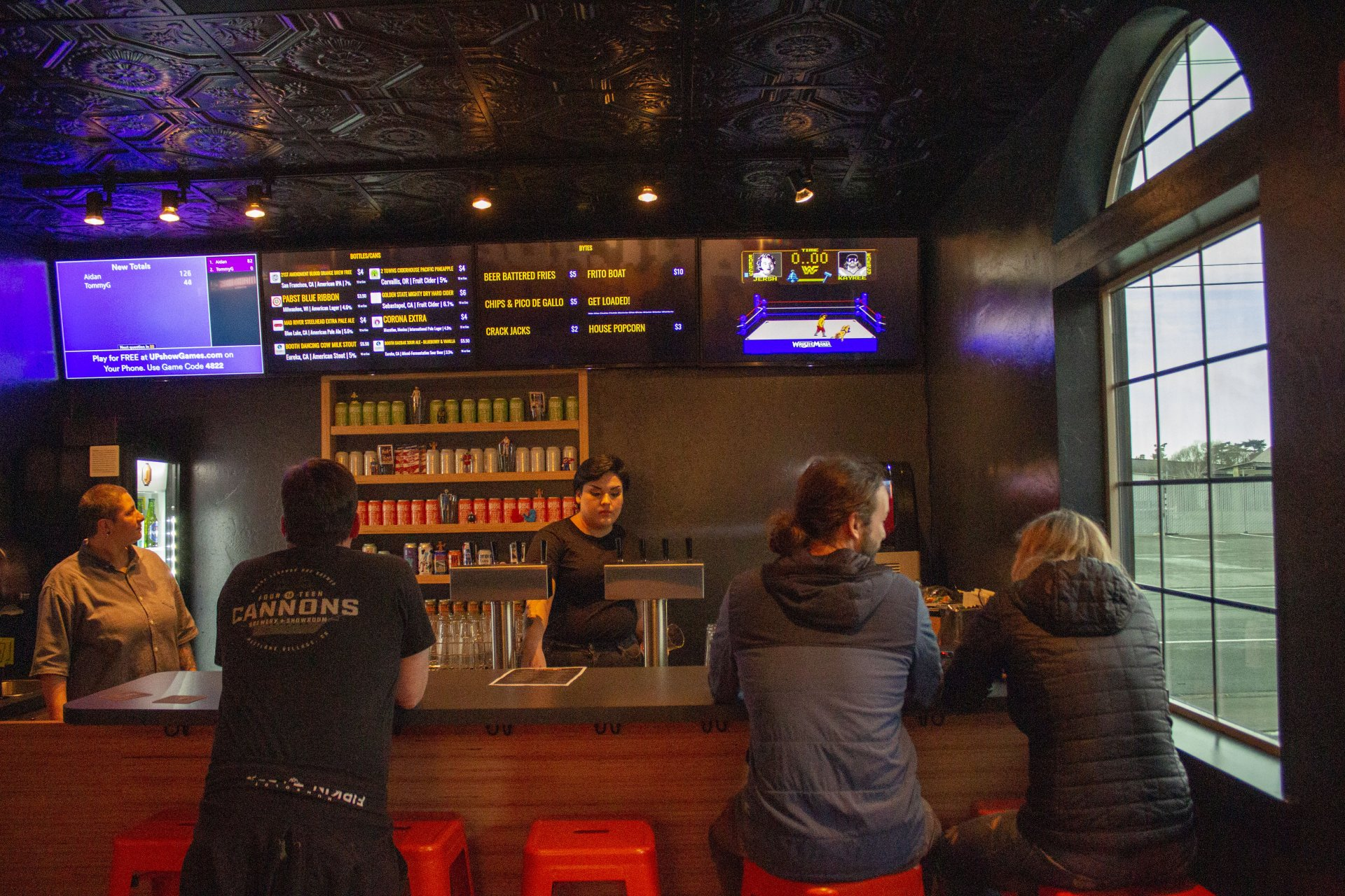 A few community members check out the new bar arcade, ARCADA, on Feb 23. | Photo by Alberto Muro