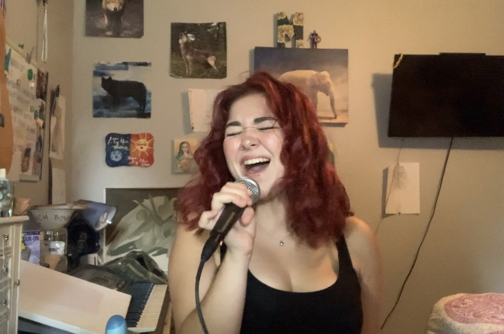 Psychology major Madelynne Avila  singing in her room. | Photo by Madelynne J. Avila