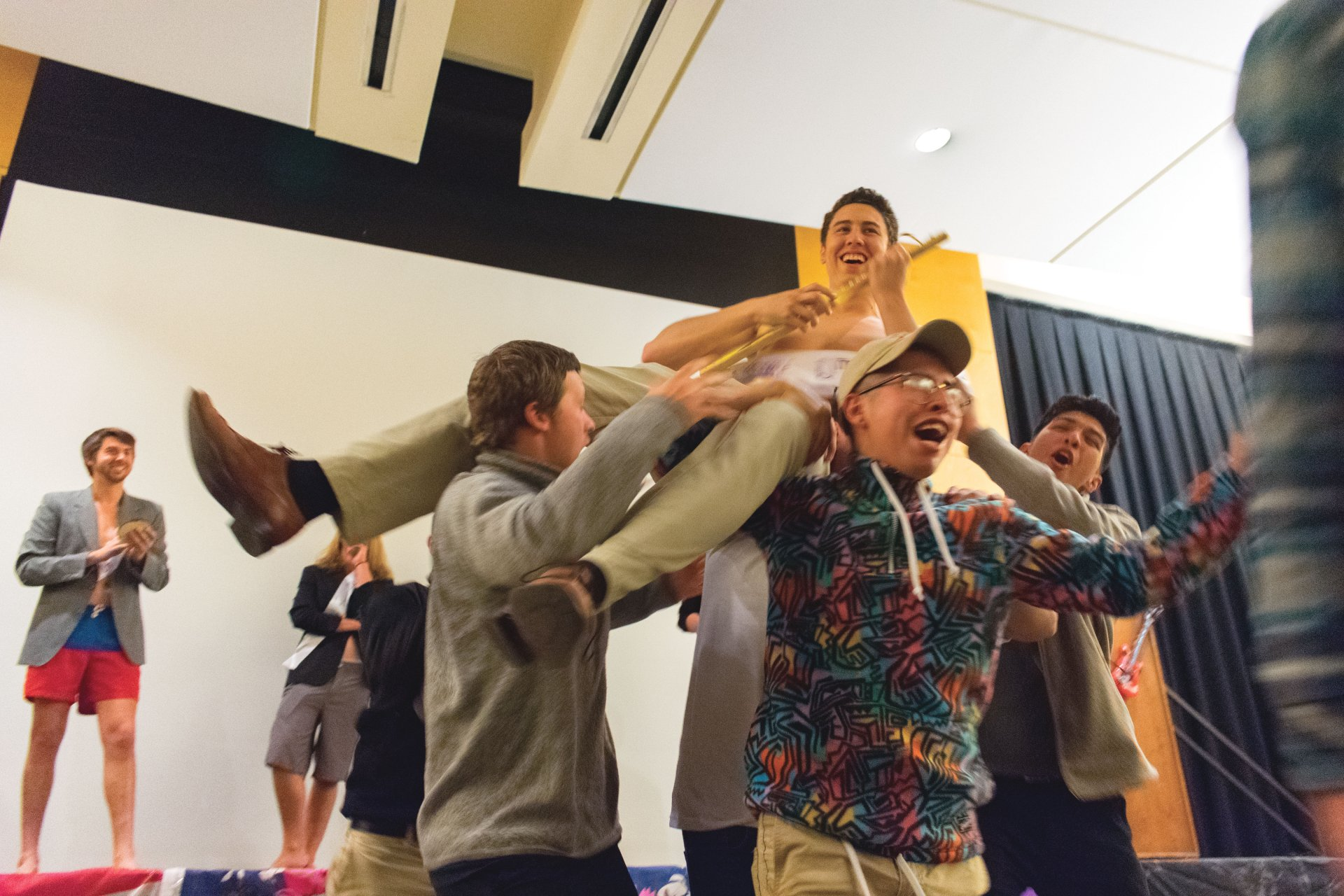 Andrew Pedroza is carried off stage by his Chi Phi fraternity brothers after being crowned the 2018 Deepher Dude in the Kate Buchanan Room on Feb. 23. Deepher Dude is Humboldt State University Delta Phi Epsilon chapter's annual male beauty pageant. Photo by Megan Bender.
