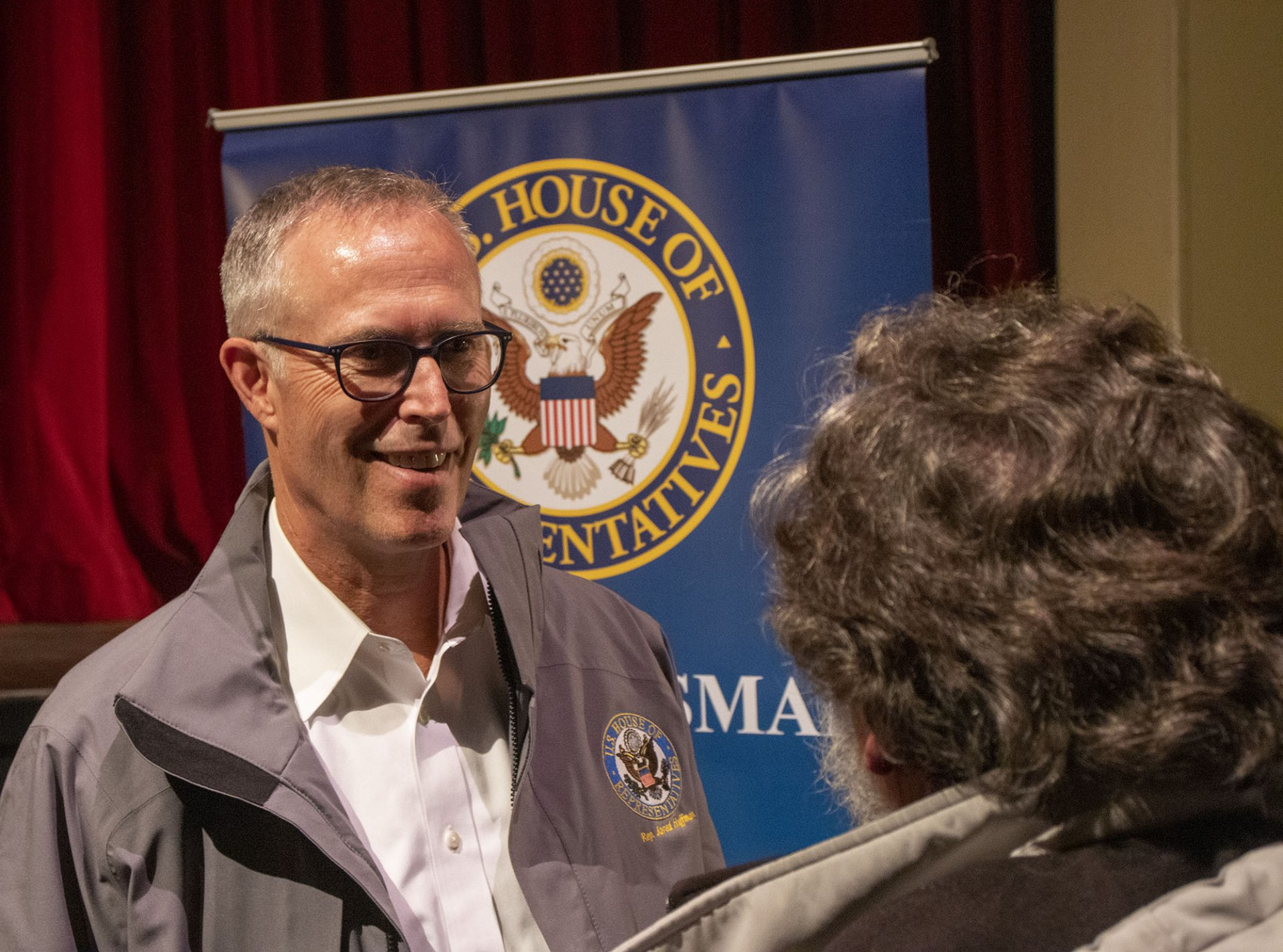 Jared Huffman stands at the front of the auditorium to meet audience members after answering questions on Feb. 21. | Photo by Kris Nagel