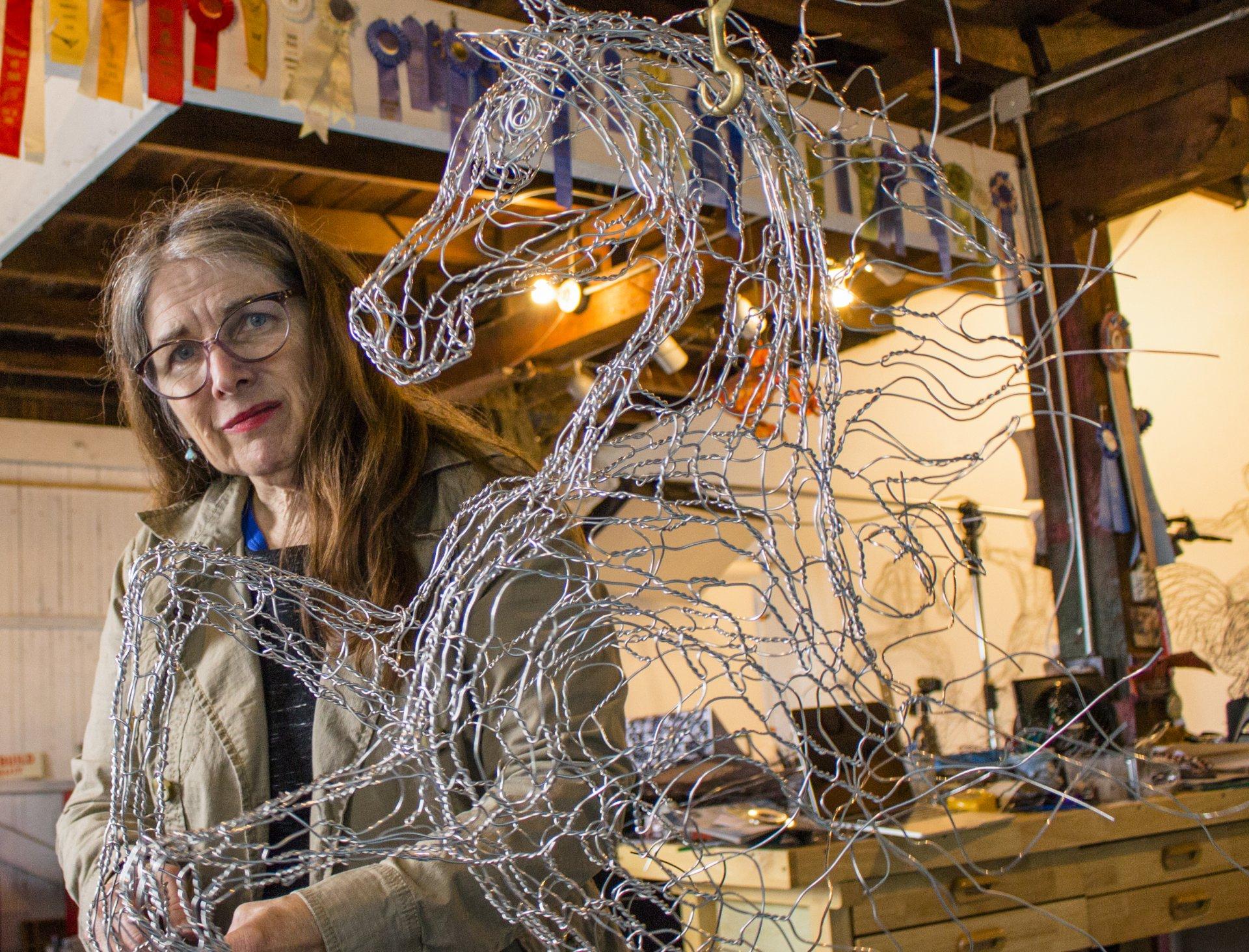 The Godmother of wire sculpture, Elizabeth Berrien in her studio on C street in Eureka, CA., Oct. 28, 2017. | Robert Brown