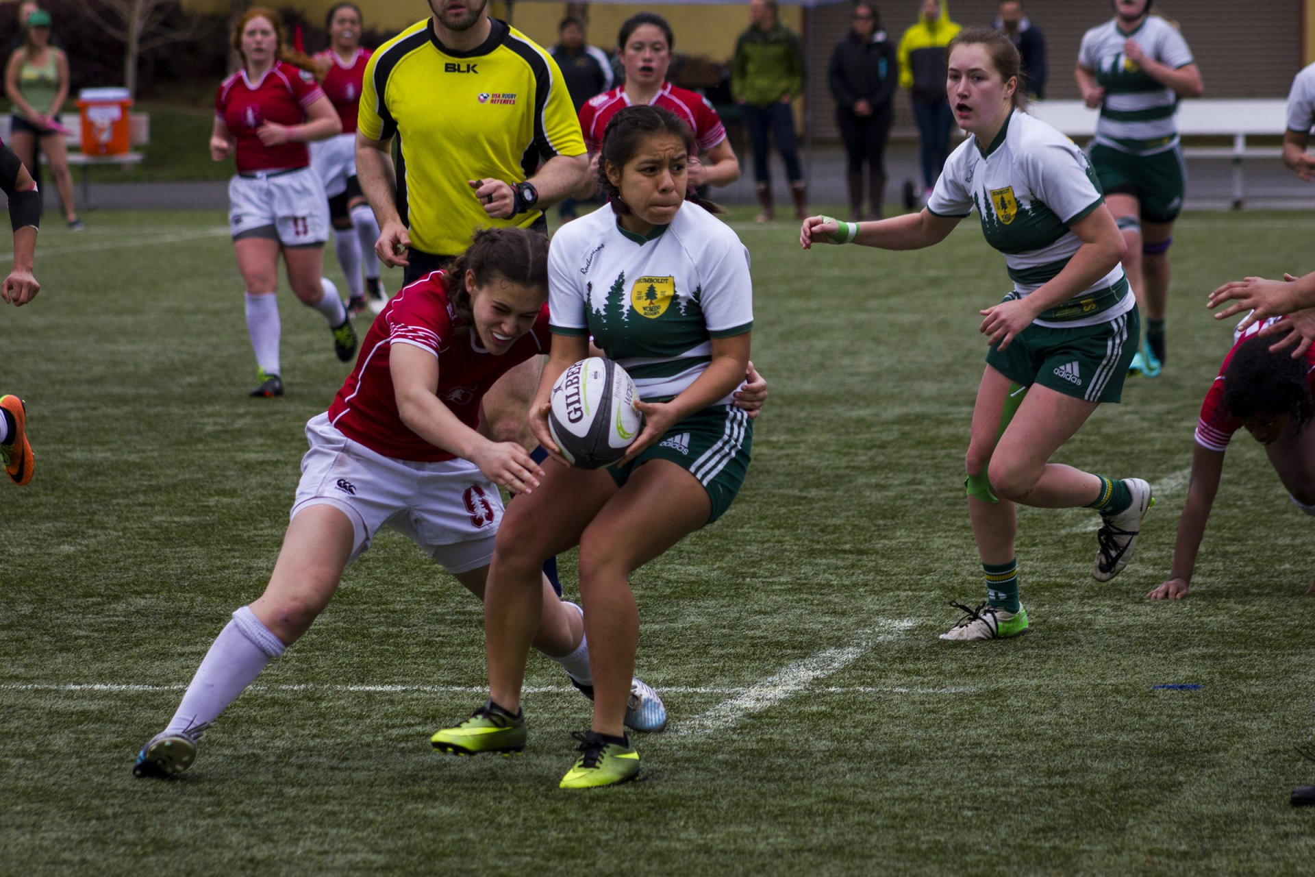 Vianey Figueroa looks to lateral the ball to a Humboldt State teammate in anticipation of a Stanford University tackle on the College Creek Field on Feb.11. Photo by Diego Linares.