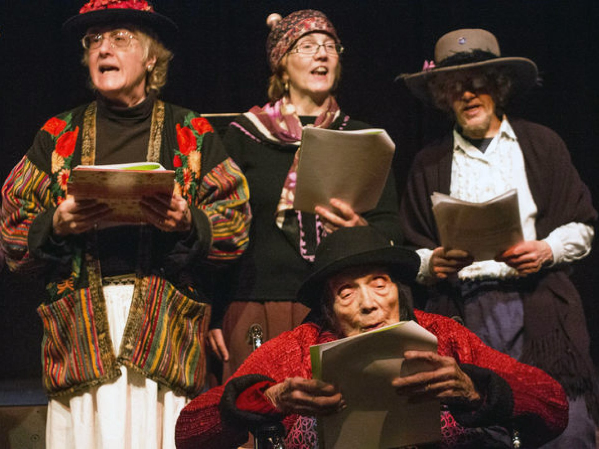 Raging Grannies, an activist organization, on stage singing at the Arcata Playhouse on March 8. Photo by Bailey Tennery.