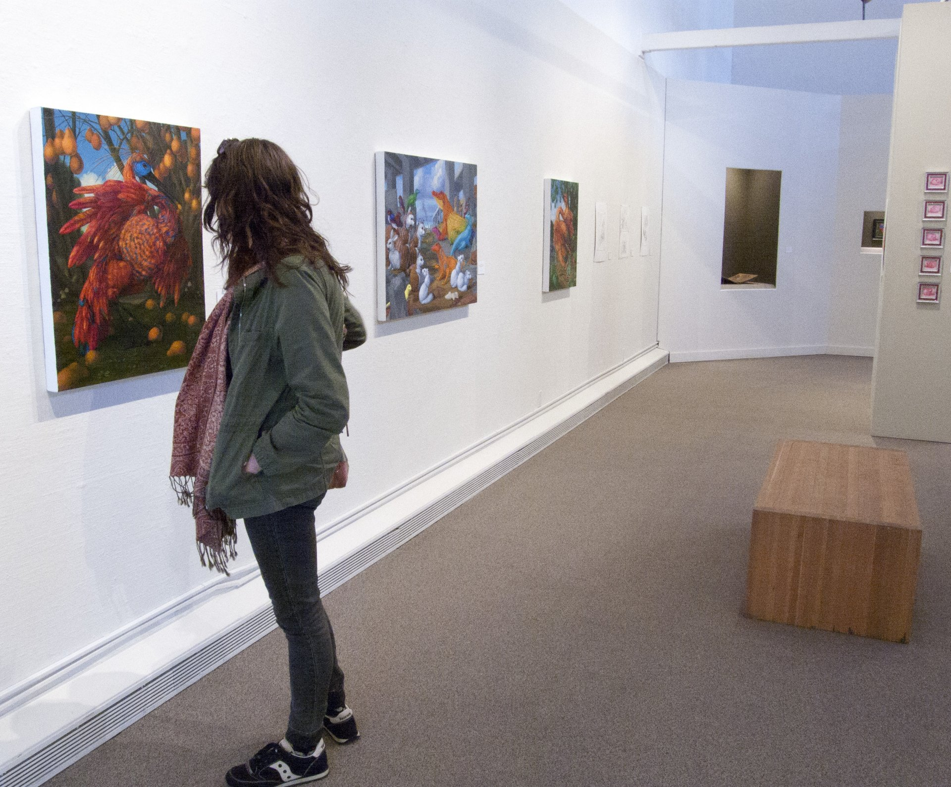 HSU alumnus Ariana Hendren admires a painting by Laurie Hogin at the Reese Bullen Gallery on  March 14. Photo by Matthew Hable.