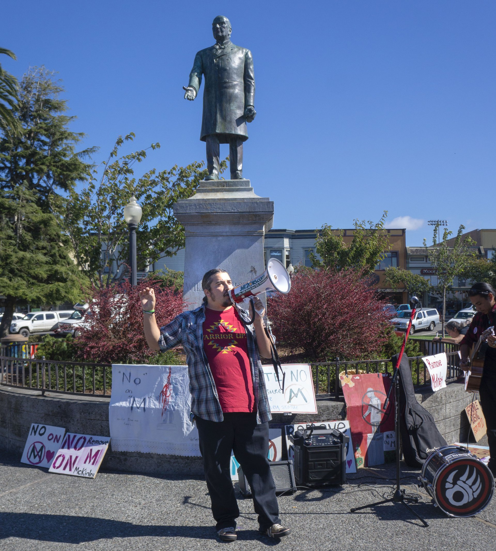 Erik Rydberg leading a group of community members in front of the statue of William McKinley in the Arcata Plaza on Oct. 8. | Photo by Stella Stokes