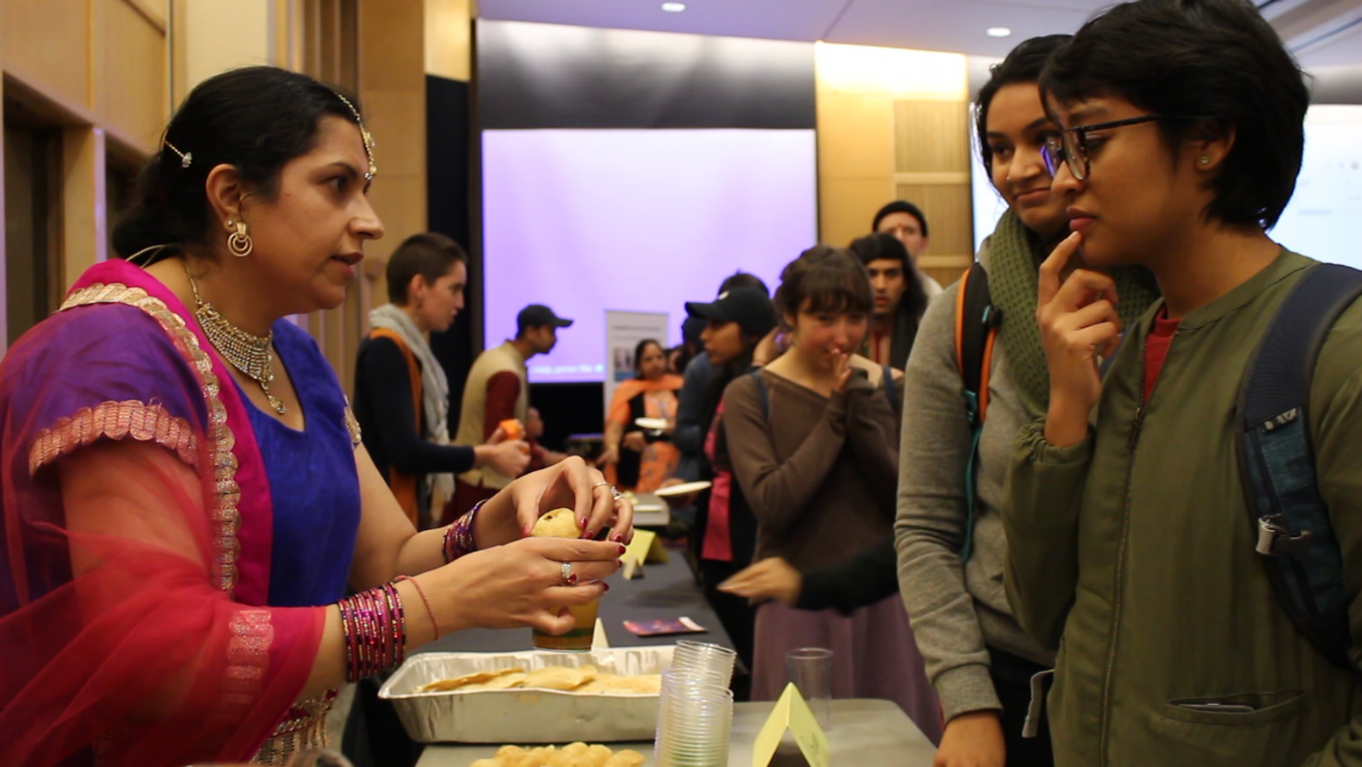 HSU students learn how to eat Golgappa, a common Indian street snack. Photo by | Sarahi Apaez